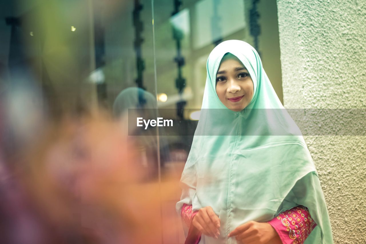 traditional clothing, wrapped, lifestyles, veil, real people, outdoors, young women, smiling, young adult, day, one person, people