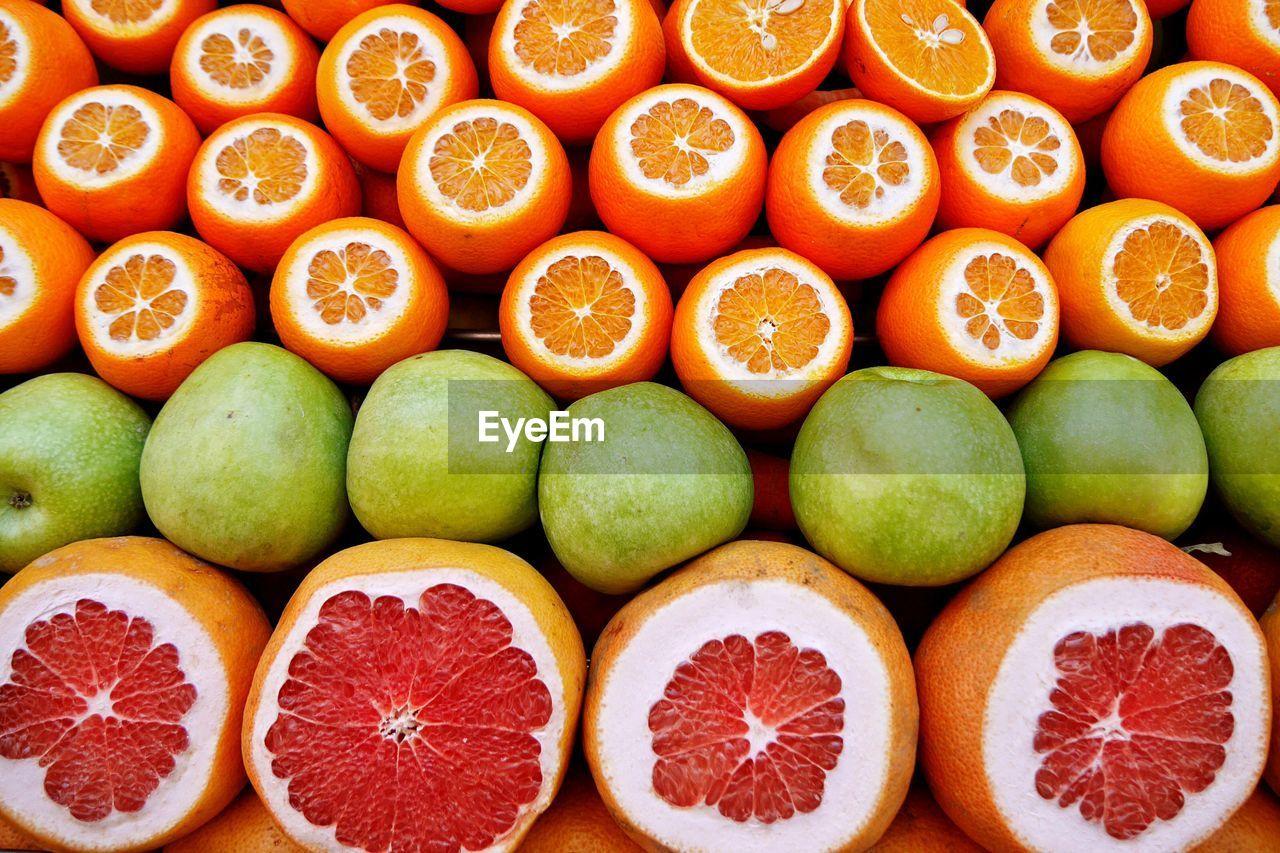 Full Frame Shot Of Citrus Fruits At Market Stall