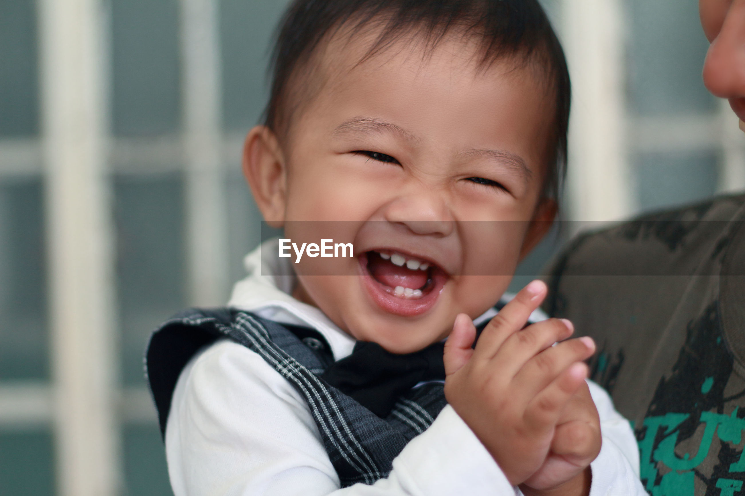 Close-up of smiling boy at home