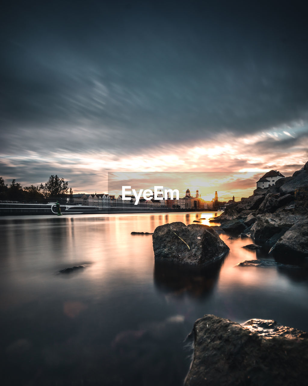 sky, water, cloud - sky, sunset, scenics - nature, rock, beauty in nature, solid, nature, tranquility, tranquil scene, reflection, rock - object, sea, no people, idyllic, long exposure, outdoors, architecture