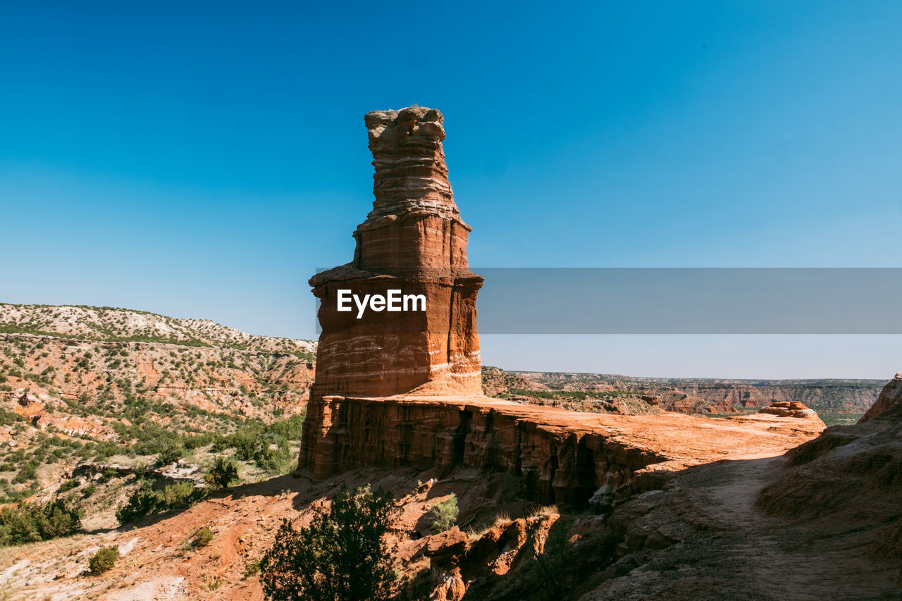 sky, nature, rock formation, beauty in nature, rock, scenics - nature, travel destinations, rock - object, non-urban scene, day, no people, solid, blue, tranquility, tranquil scene, travel, physical geography, sunlight, tourism, clear sky, outdoors, eroded