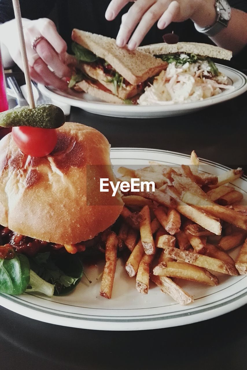 Close-Up Of Hamburger With French Fries In Plate