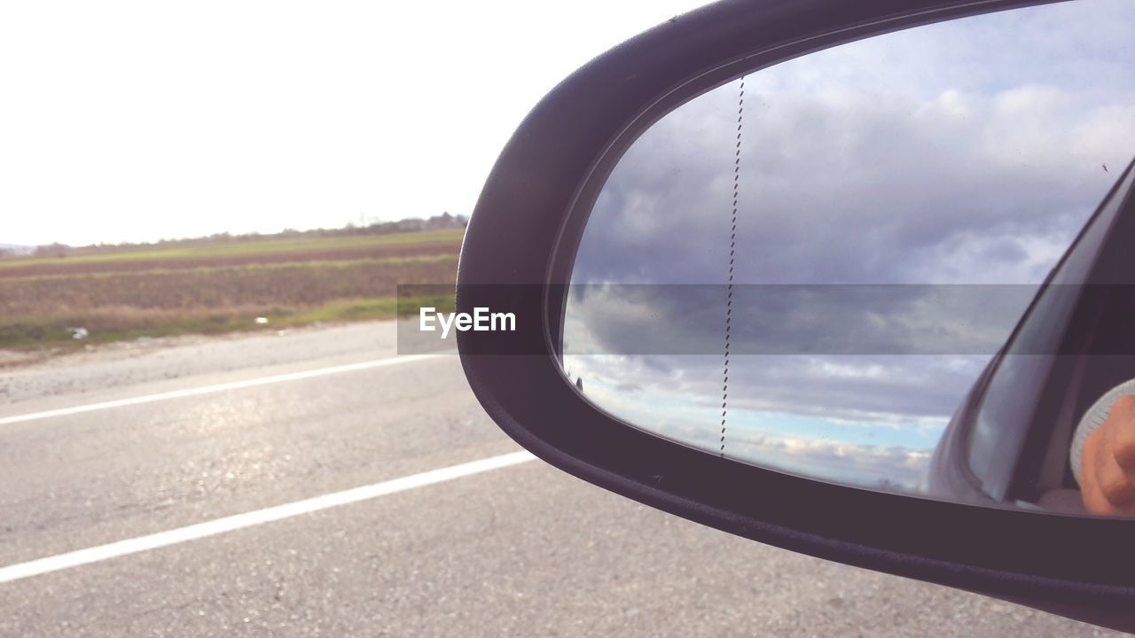 transportation, side-view mirror, mode of transport, road, no people, sky, close-up, day, land vehicle, outdoors, vehicle part, nature