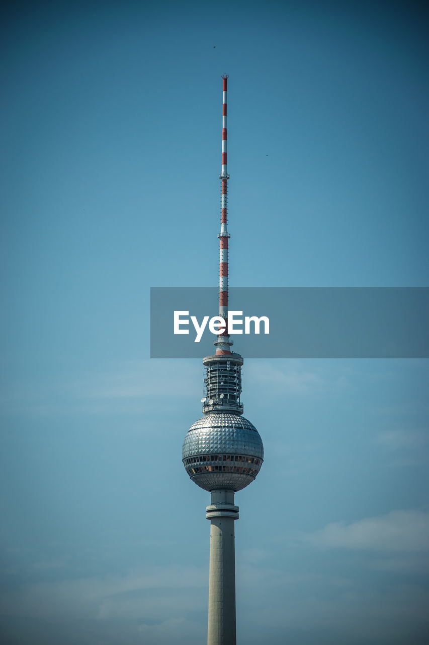 Low Angle View Of Fernsehturm Against Blue Sky In City