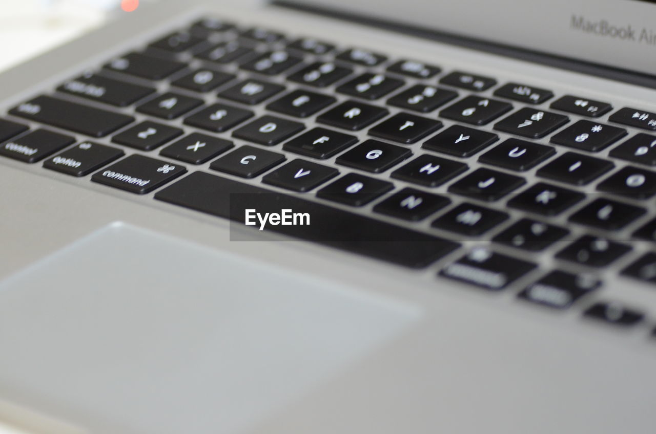 computer, technology, keyboard, communication, computer equipment, wireless technology, computer keyboard, laptop, connection, selective focus, indoors, close-up, alphabet, letter, no people, computer part, portable information device, text, still life, table, computer key