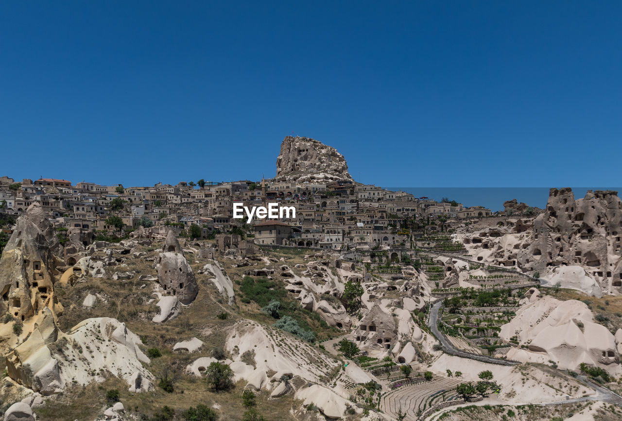 sky, clear sky, copy space, nature, scenics - nature, tranquil scene, architecture, no people, environment, landscape, blue, day, tranquility, mountain, rock, history, travel destinations, the past, rock formation, beauty in nature, outdoors, ancient civilization, climate, arid climate