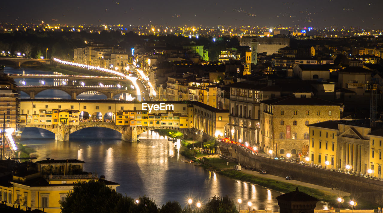 Illuminated Ponte Vecchio Over Arno River At Night
