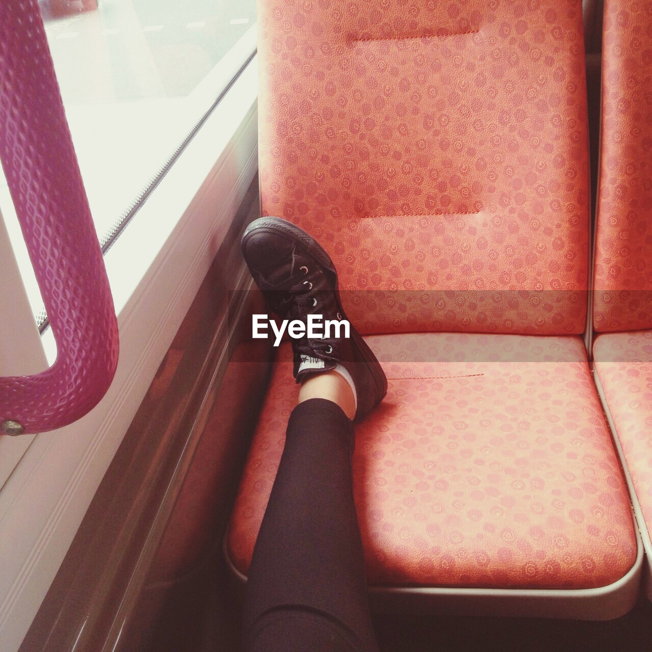 indoors, low section, high angle view, red, shoe, person, part of, footwear, day, close-up, sitting, human foot, transportation, window, sunlight, personal perspective, standing