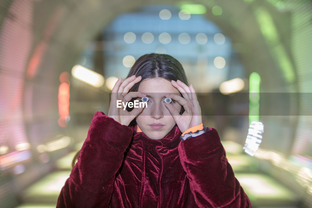 front view, one person, real people, focus on foreground, headshot, lifestyles, portrait, leisure activity, illuminated, looking at camera, clothing, casual clothing, young adult, red, men, warm clothing, eyeglasses, waist up, scarf, contemplation, teenager