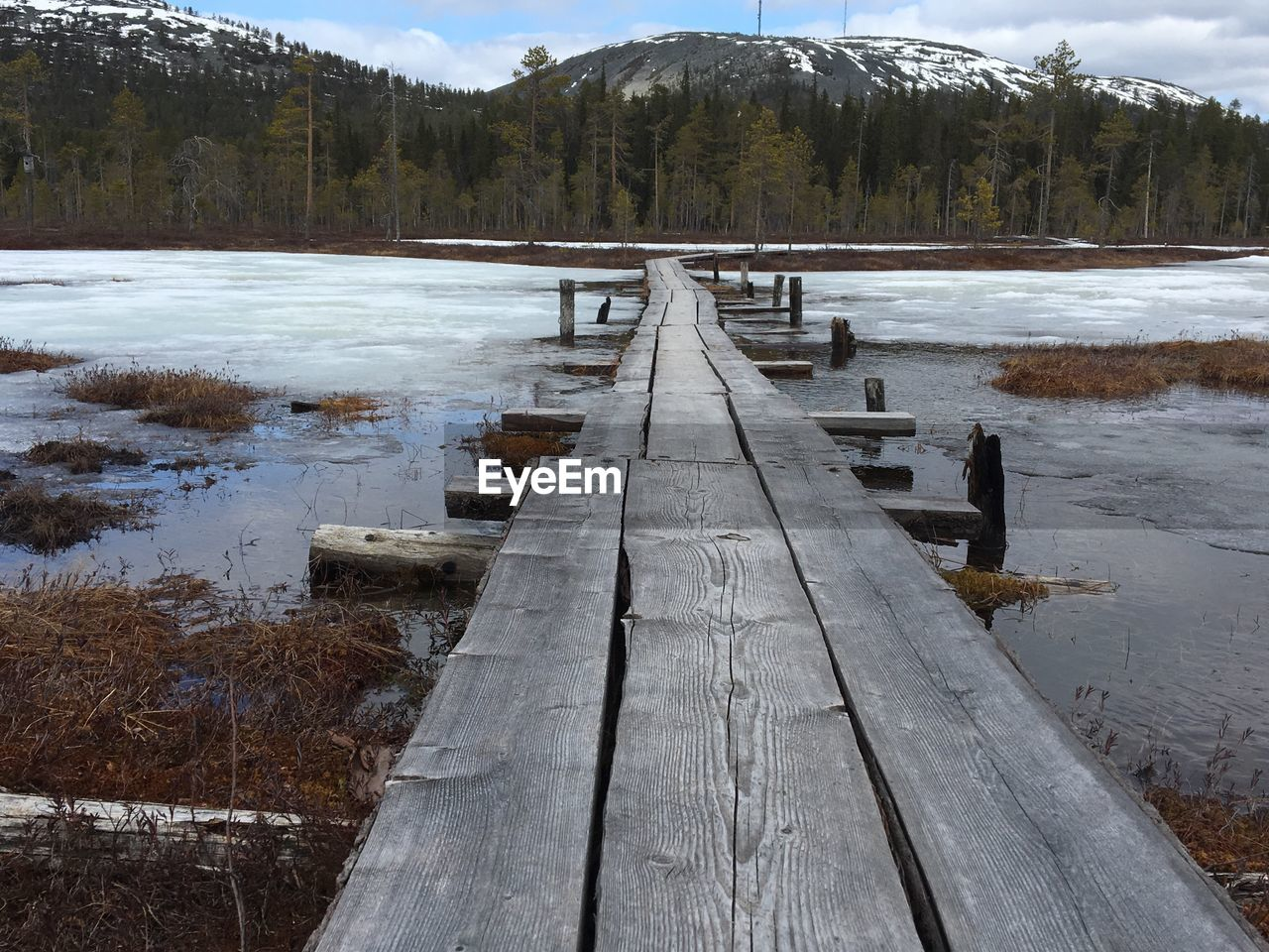 nature, outdoors, water, lake, day, tree, wood - material, cold temperature, winter, snow, scenics, tranquility, tranquil scene, mountain, no people, beauty in nature, jetty, frozen, landscape, mountain range, forest, sky