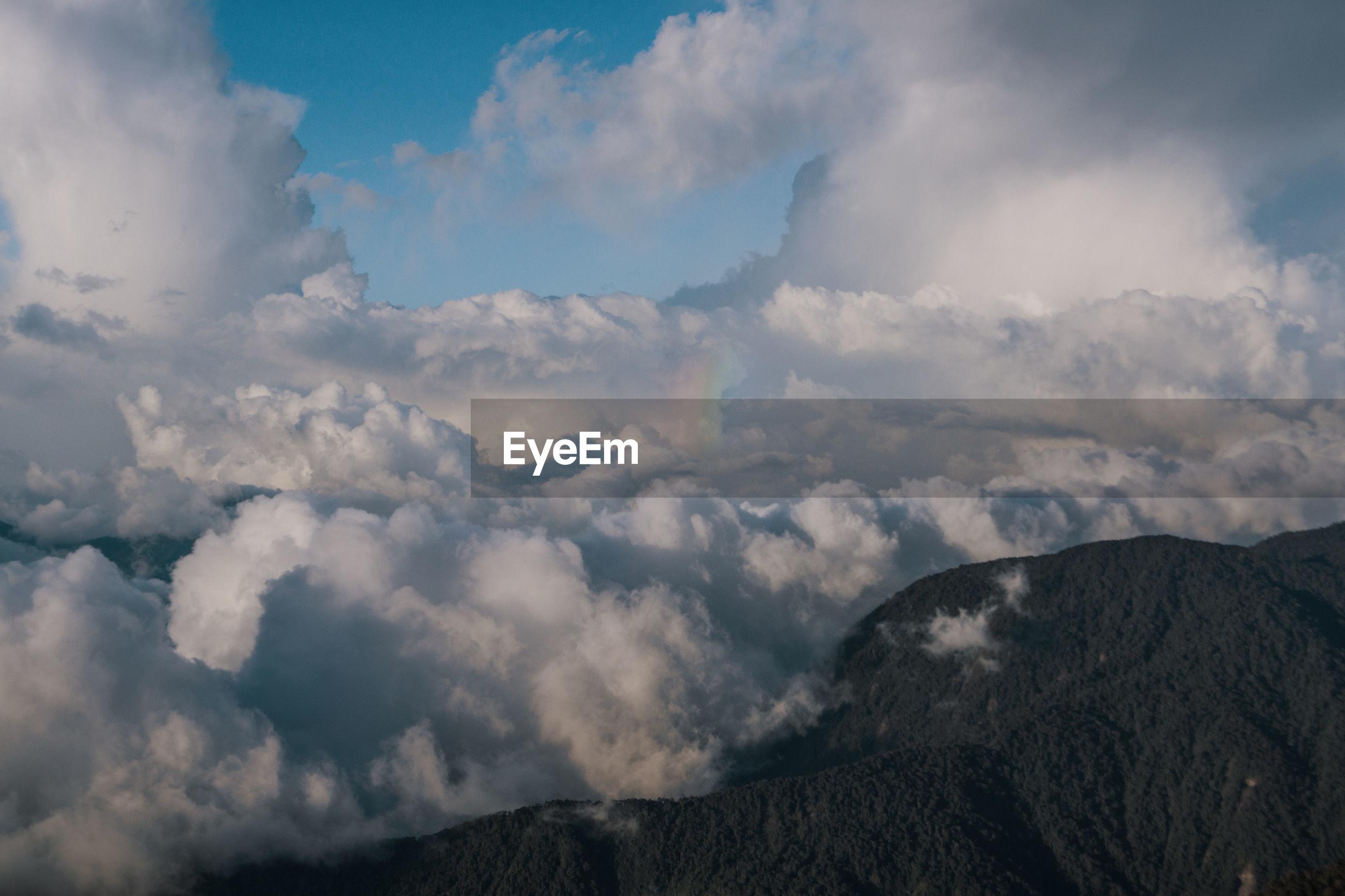 Cloudscape against mountains