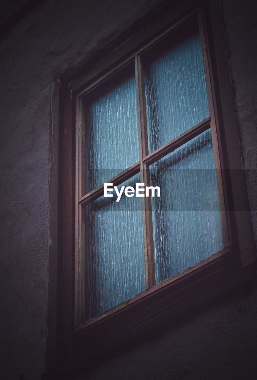 window, indoors, no people, architecture, glass - material, wall - building feature, day, built structure, curtain, home interior, wood - material, security, house, close-up, protection, wall, safety, transparent, building, dark, glass, window frame