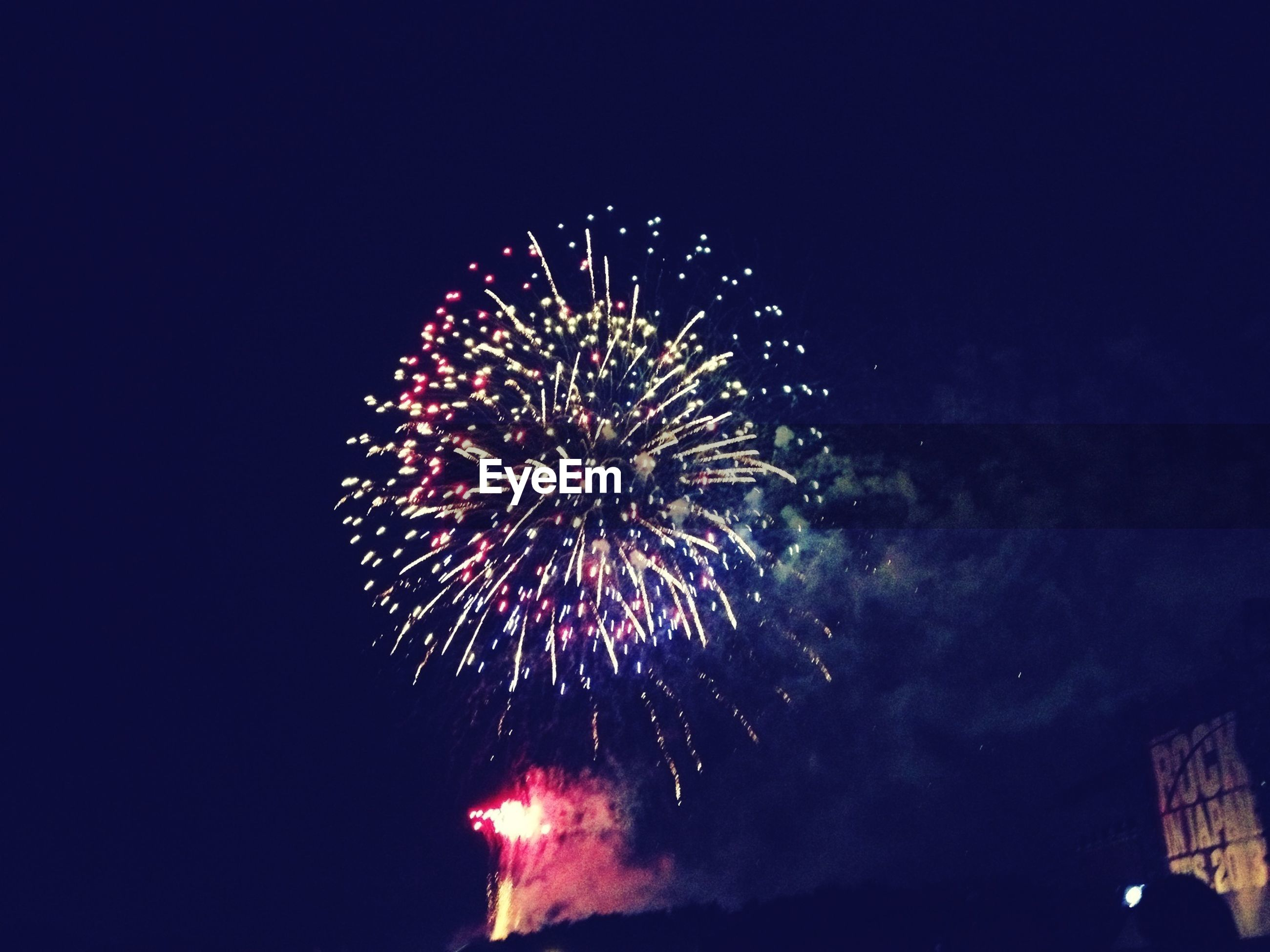 firework display, night, illuminated, exploding, celebration, firework - man made object, long exposure, arts culture and entertainment, low angle view, motion, sparks, event, glowing, firework, sky, entertainment, blurred motion, multi colored, celebration event, fire - natural phenomenon