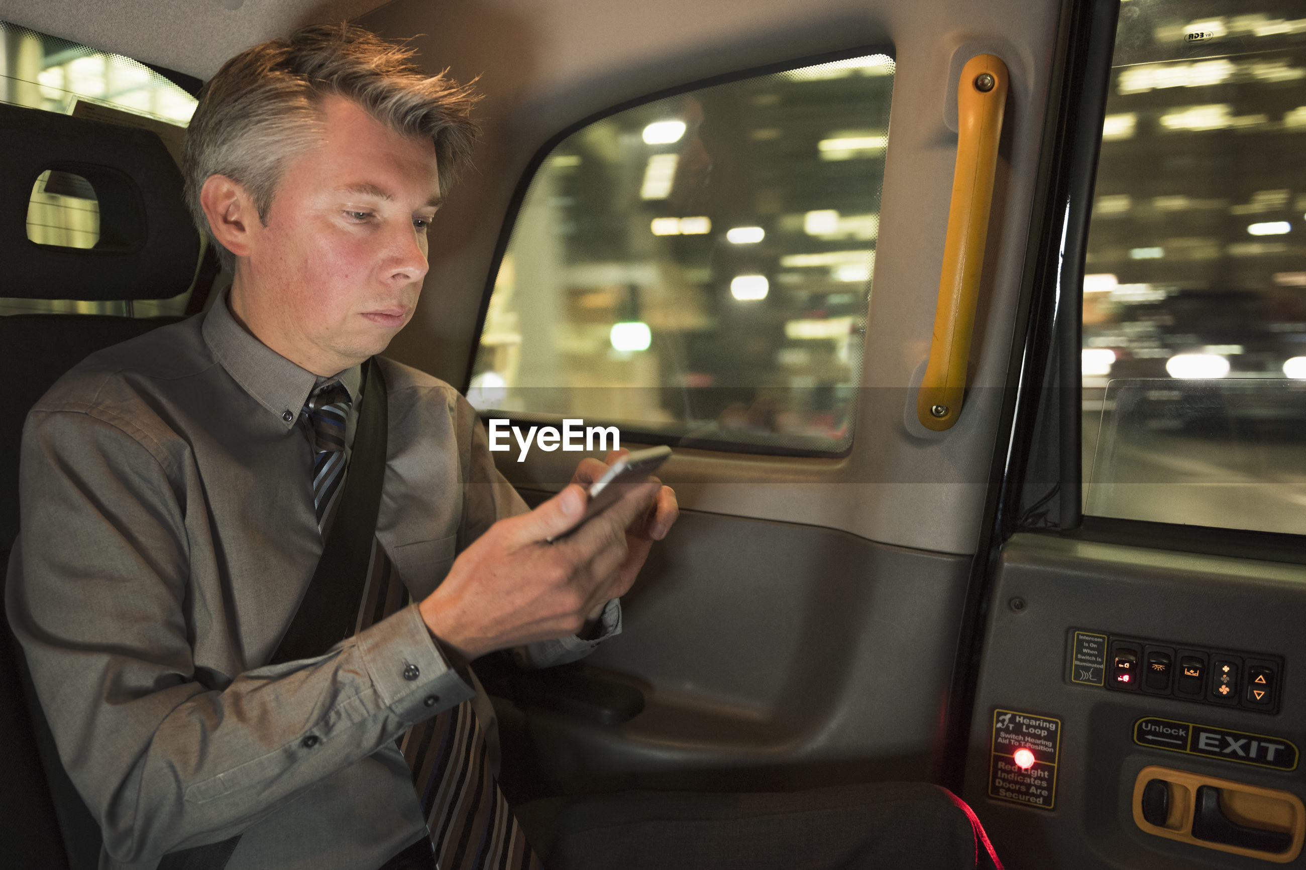 Man using phone while sitting in car