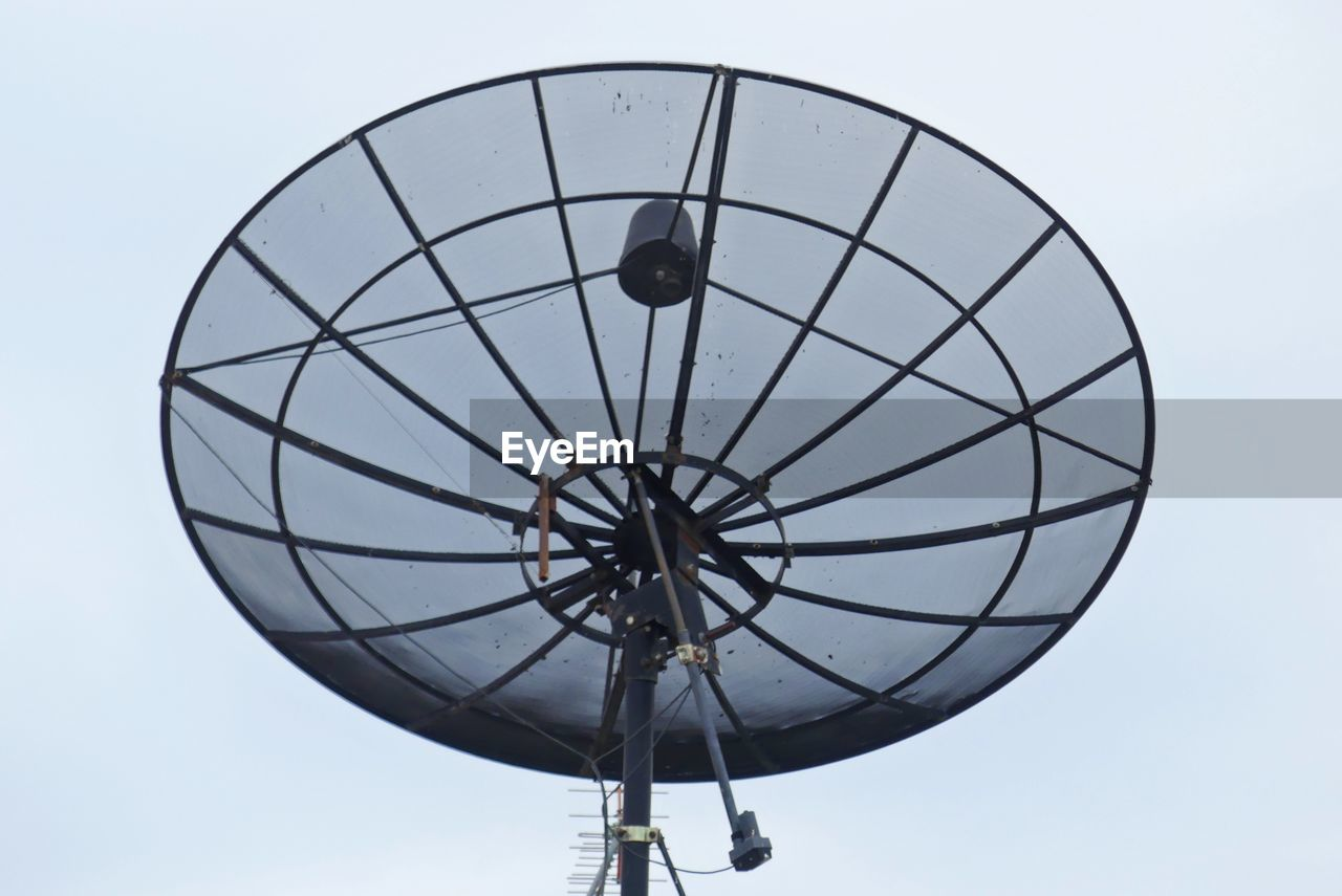 sky, low angle view, nature, clear sky, day, geometric shape, circle, outdoors, communication, shape, no people, technology, sport, sphere, equipment, metal, satellite, leisure activity, close-up, satellite dish, global communications