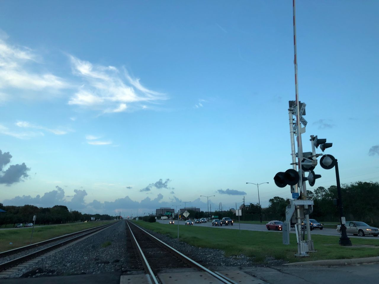 rail transportation, track, sky, railroad track, transportation, mode of transportation, signal, railway signal, nature, cloud - sky, public transportation, no people, train, day, outdoors, plant, train - vehicle, field, direction, travel
