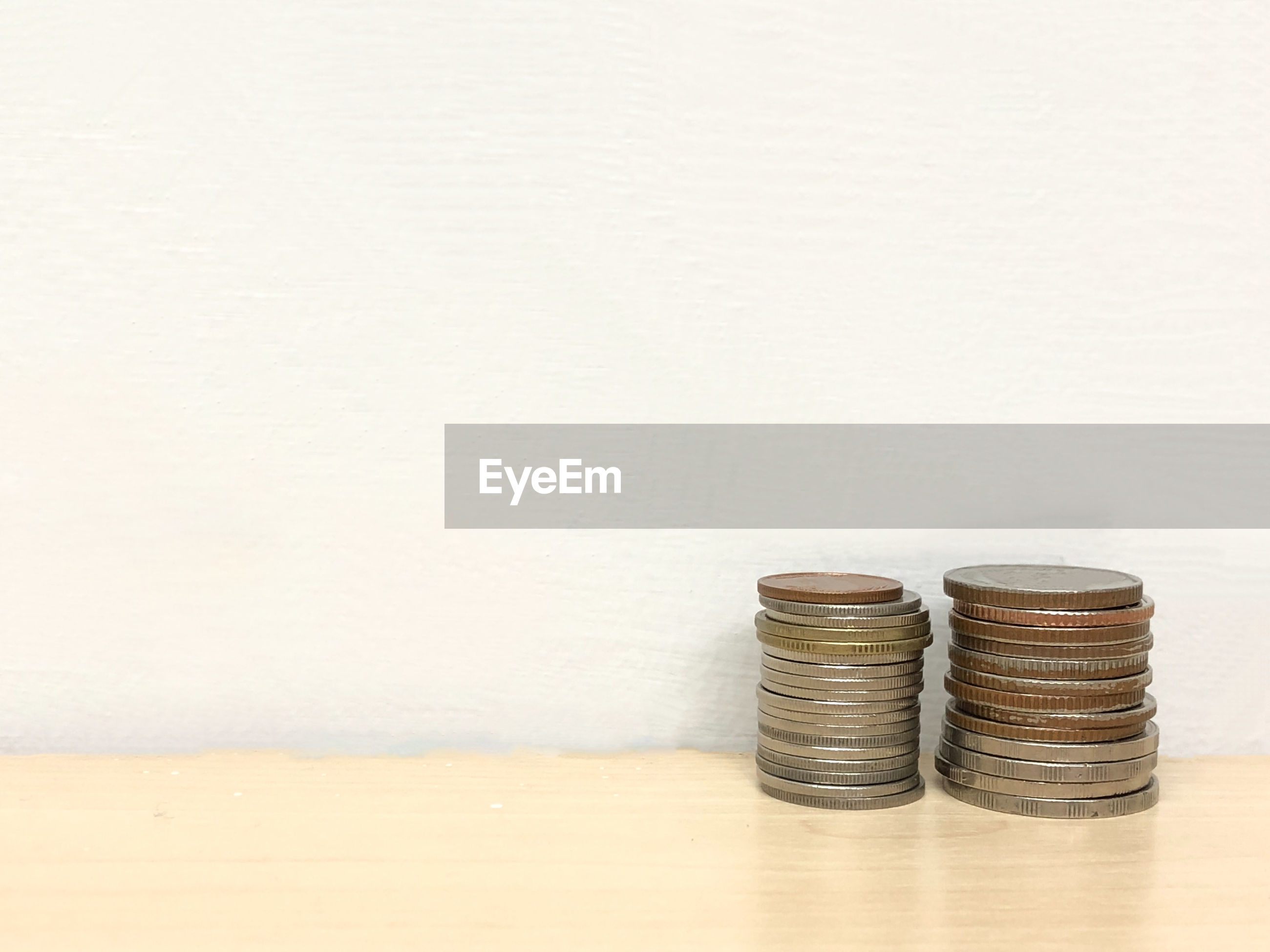 Stack of coins on wooden table