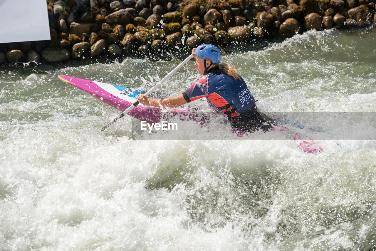 MAN SURFING ON WATER