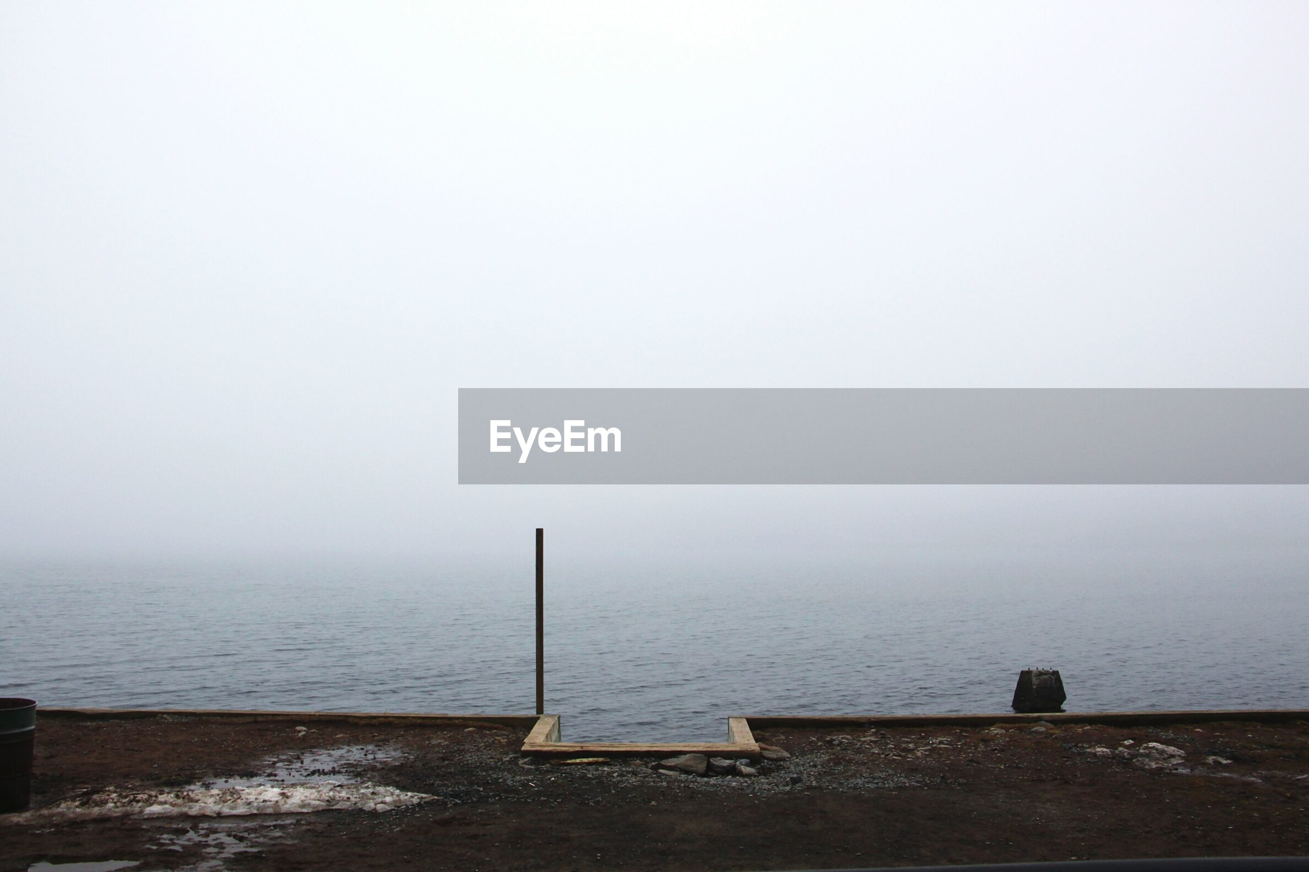 SCENIC VIEW OF SEA AGAINST SKY AT FOGGY WEATHER
