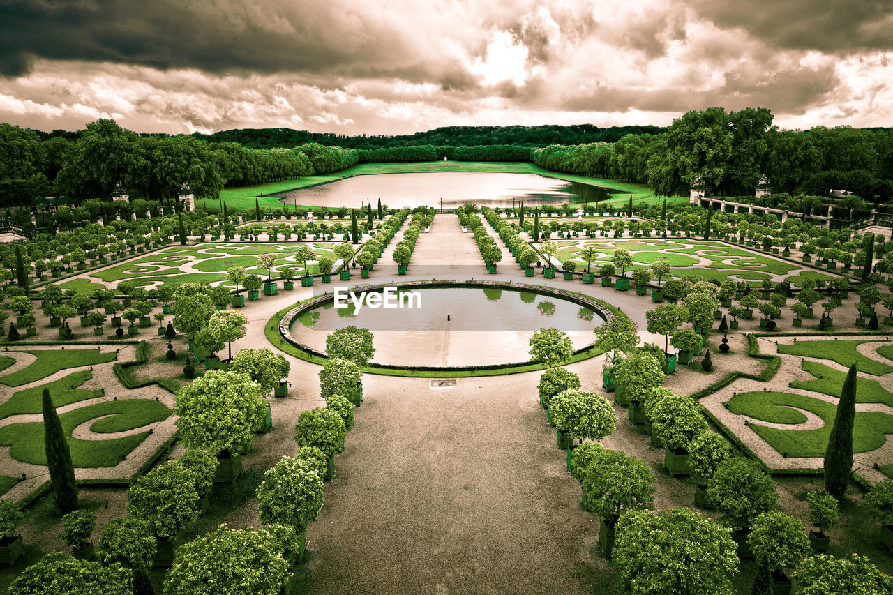 plant, green color, sky, garden, architecture, tree, hedge, nature, cloud - sky, formal garden, day, no people, the way forward, grass, outdoors, history, direction, beauty in nature, the past, built structure, ornamental garden
