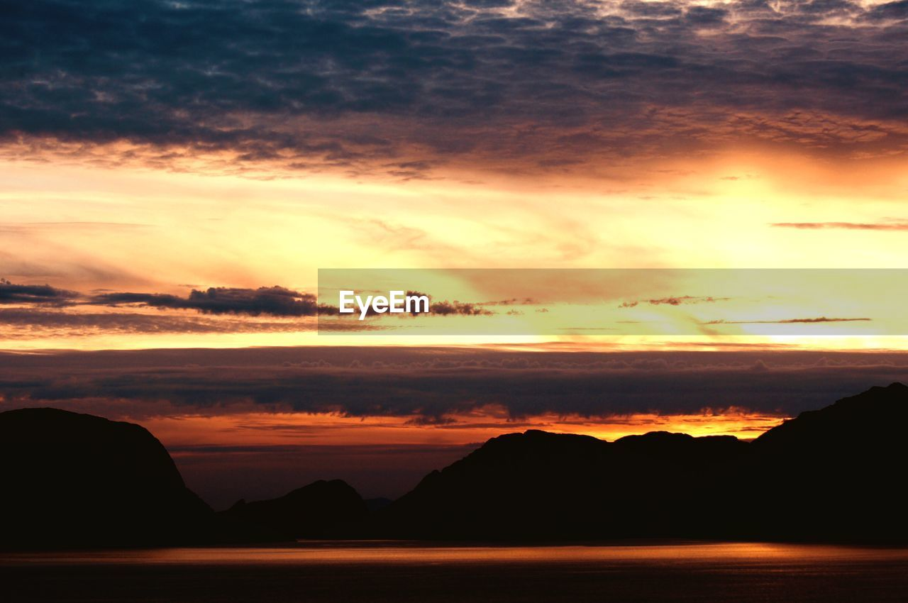 sunset, sky, cloud - sky, beauty in nature, scenics - nature, tranquil scene, tranquility, orange color, silhouette, nature, idyllic, mountain, water, no people, outdoors, non-urban scene, sea, dramatic sky, majestic, romantic sky