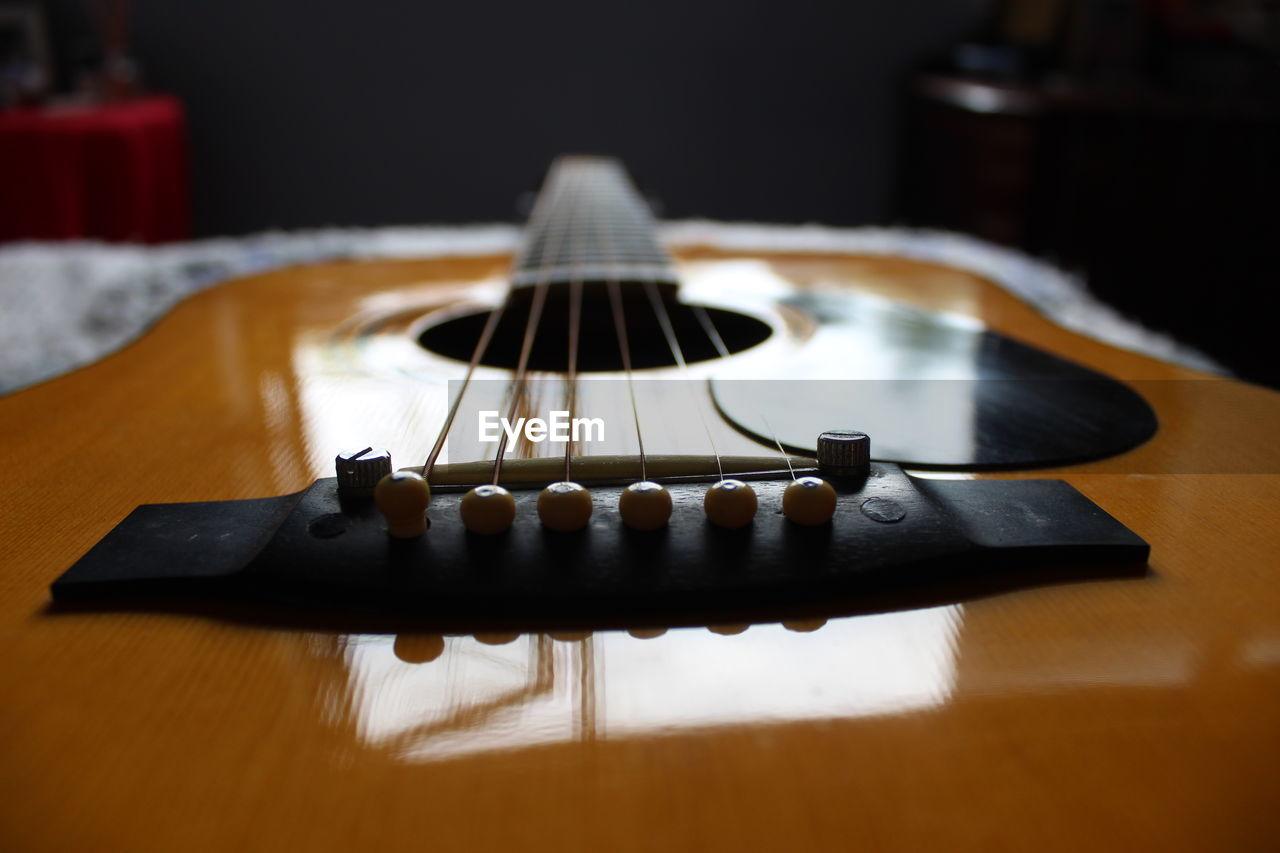 Close-up of guitar at home