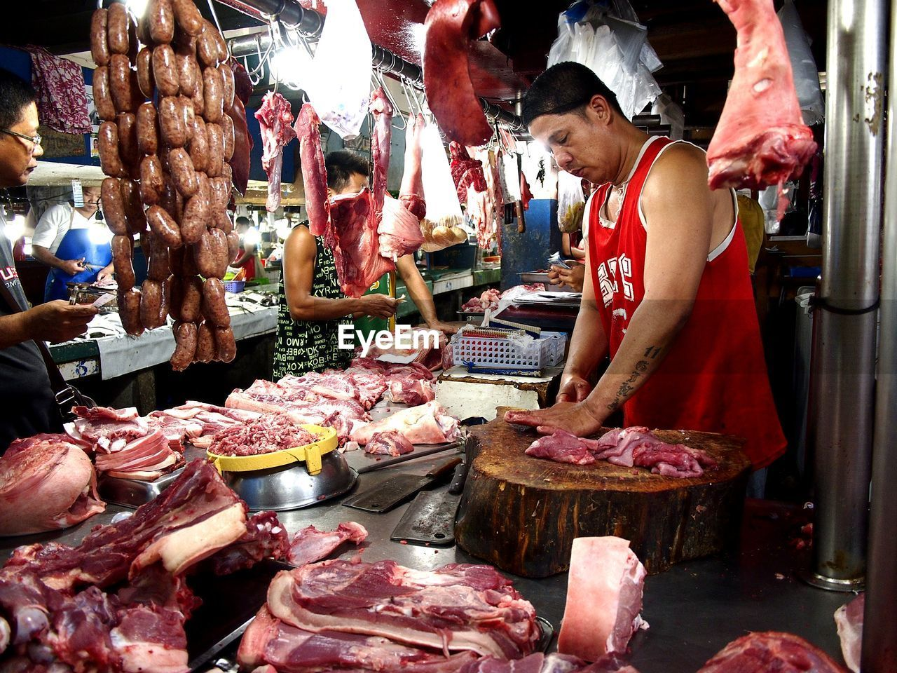 meat, market, retail, food and drink, freshness, food, choice, business, occupation, market stall, for sale, variation, butcher, real people, people, group of people, preparation, raw food, small business, men, buying, fish market, sale, consumerism, retail display
