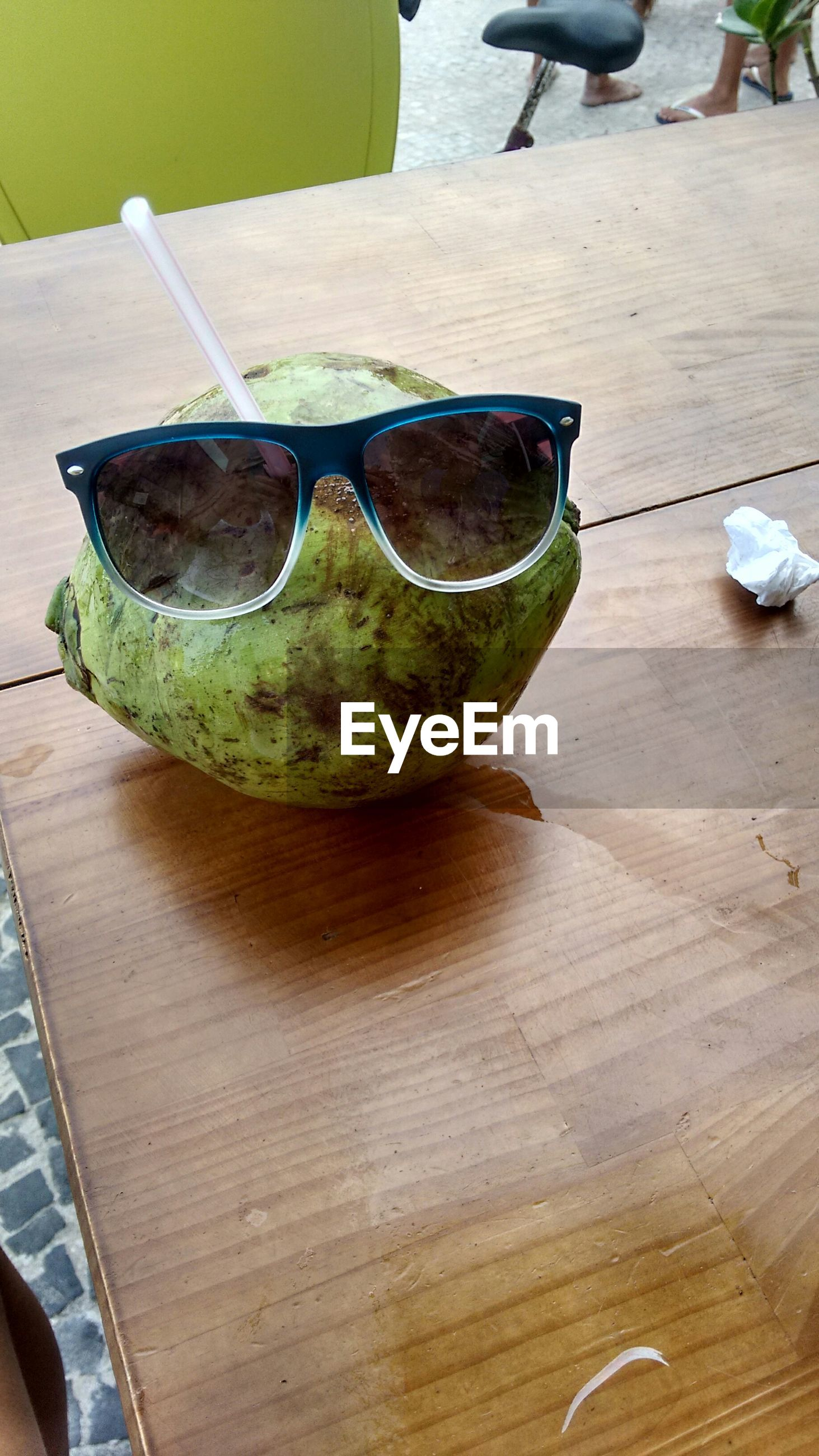 High angle view of sunglasses on coconut