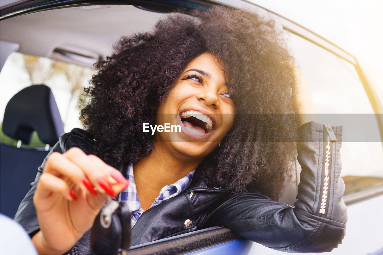 Smiling Young Woman In Car