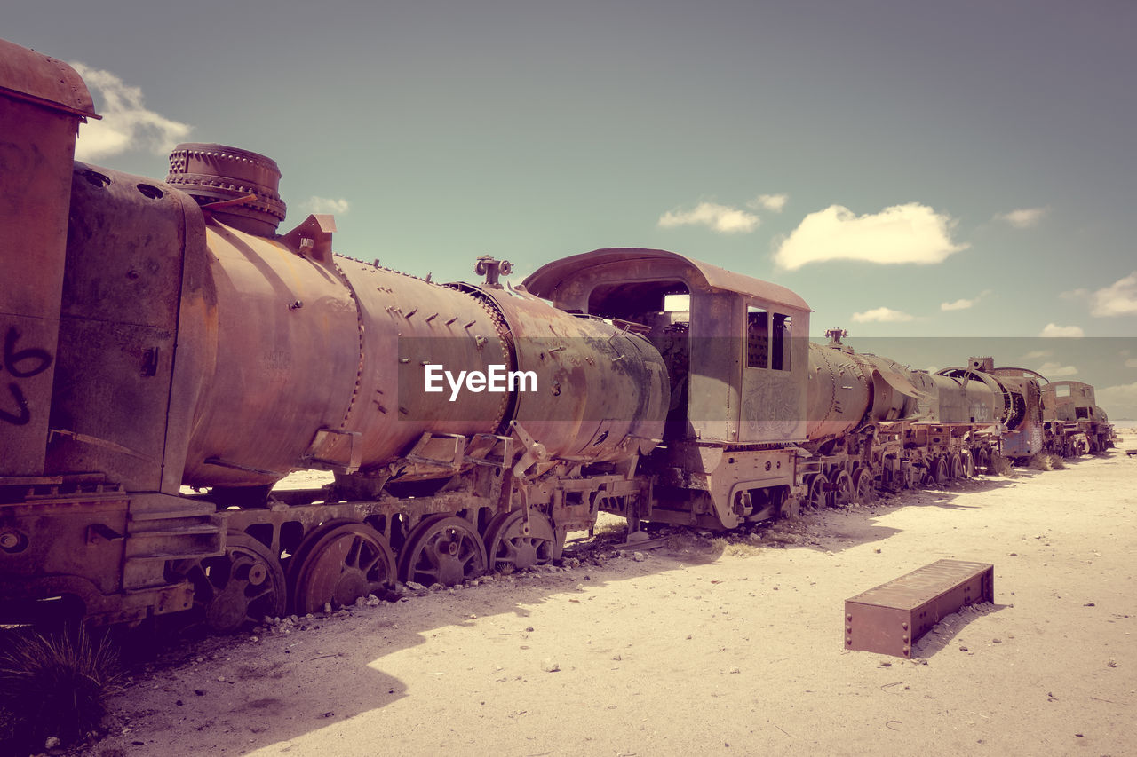 train, rail transportation, train - vehicle, transportation, mode of transportation, sky, day, nature, business, freight transportation, freight train, land, railroad track, track, public transportation, outdoors, rusty, no people, sunlight, travel, shunting yard, ruined