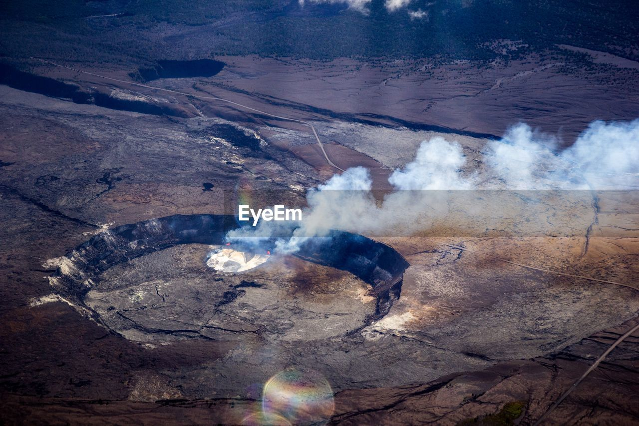 smoke - physical structure, heat - temperature, geology, nature, no people, high angle view, landscape, day, environment, mountain, non-urban scene, land, rock, physical geography, scenics - nature, outdoors, beauty in nature, emitting, rock - object, remote, power in nature, pollution, volcanic crater