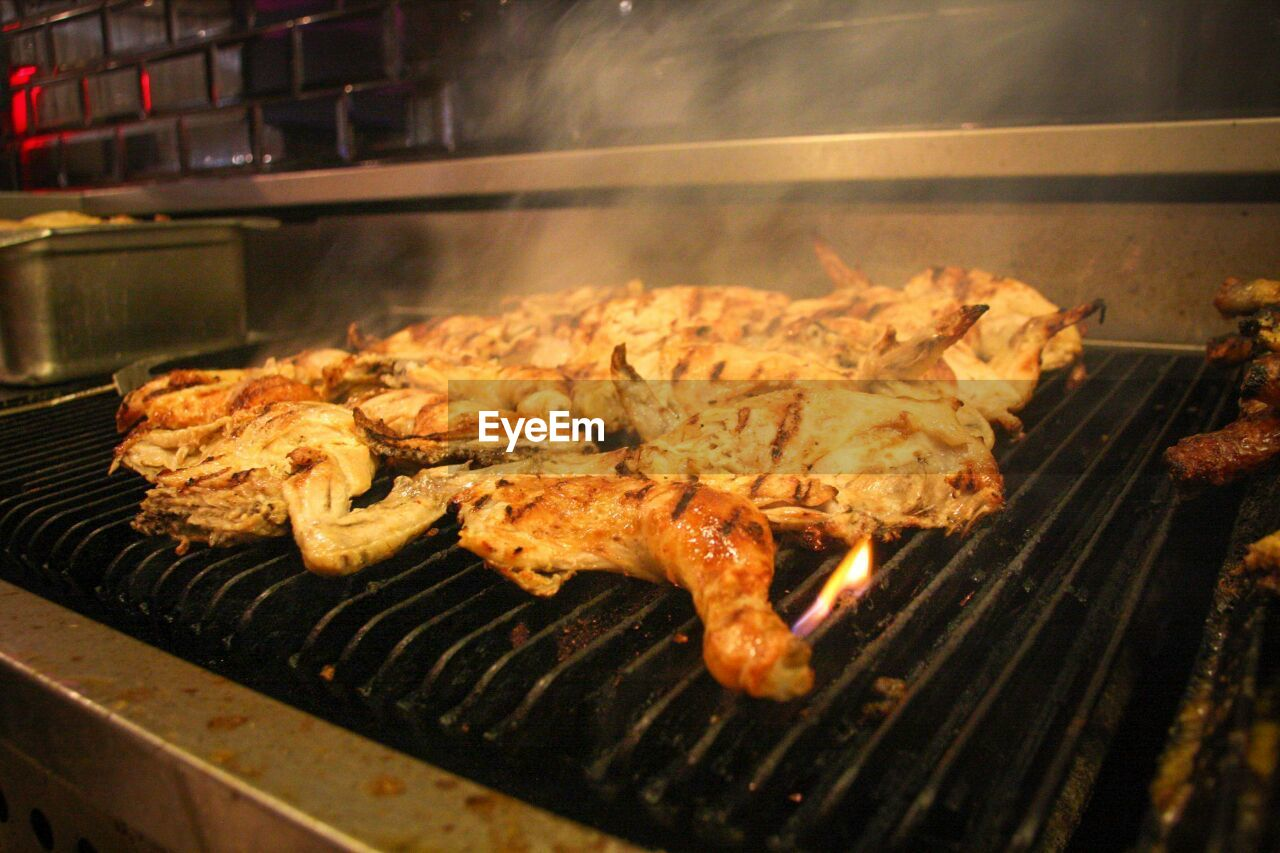 food and drink, food, freshness, preparation, barbecue, meat, grilled, heat - temperature, close-up, barbecue grill, preparing food, no people, healthy eating, wellbeing, indoors, still life, smoke - physical structure, high angle view, burning, selective focus, snack
