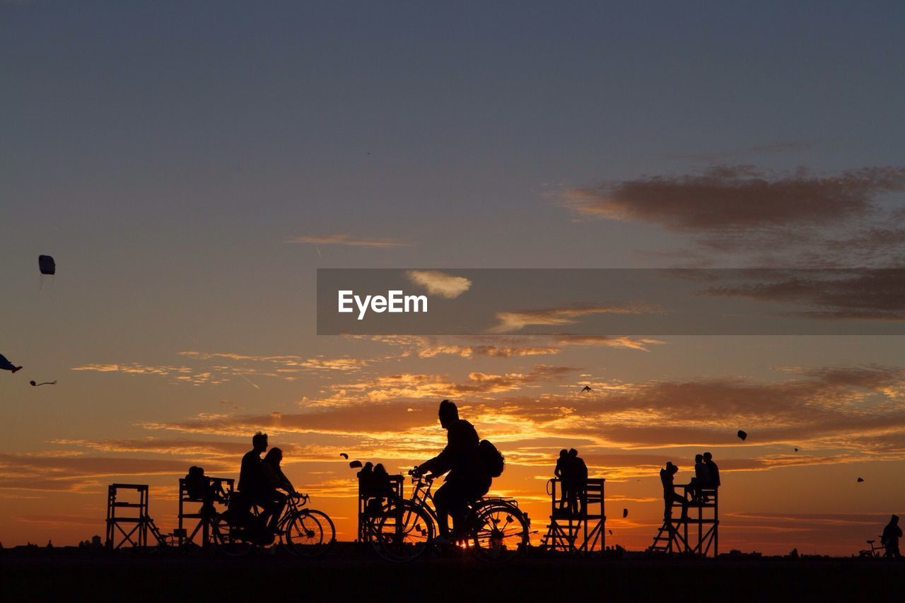 Silhouette Of Cyclists At Sunset