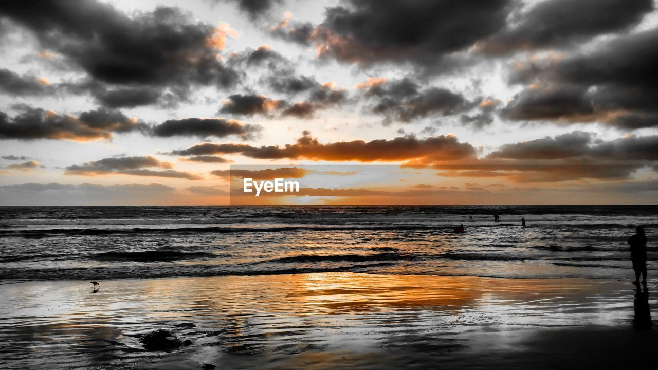 sunset, beauty in nature, sea, nature, scenics, water, cloud - sky, tranquility, sky, tranquil scene, dramatic sky, horizon over water, outdoors, no people, beach, storm cloud, day