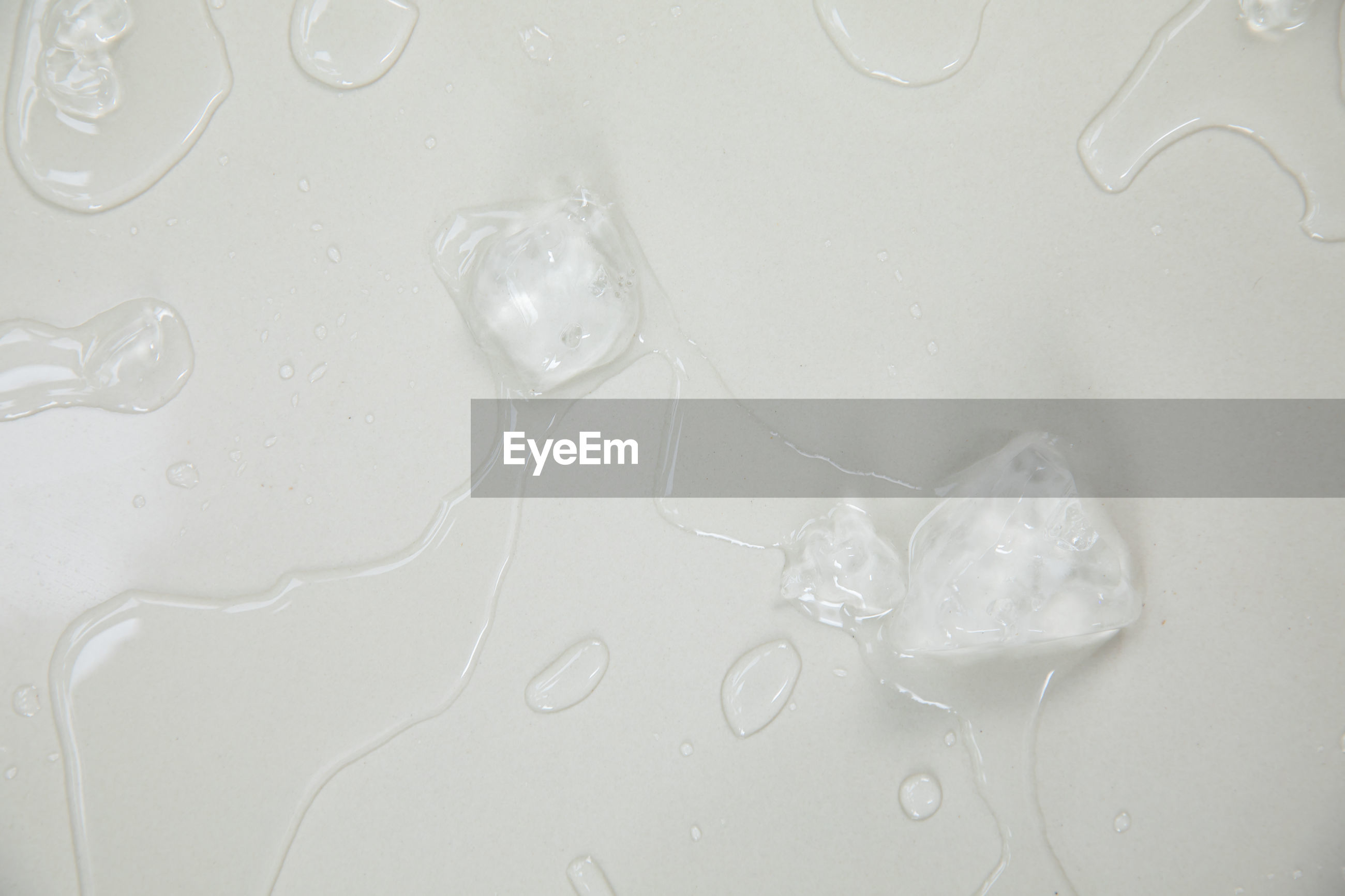 HIGH ANGLE VIEW OF WATER DROPS ON WHITE BACKGROUND