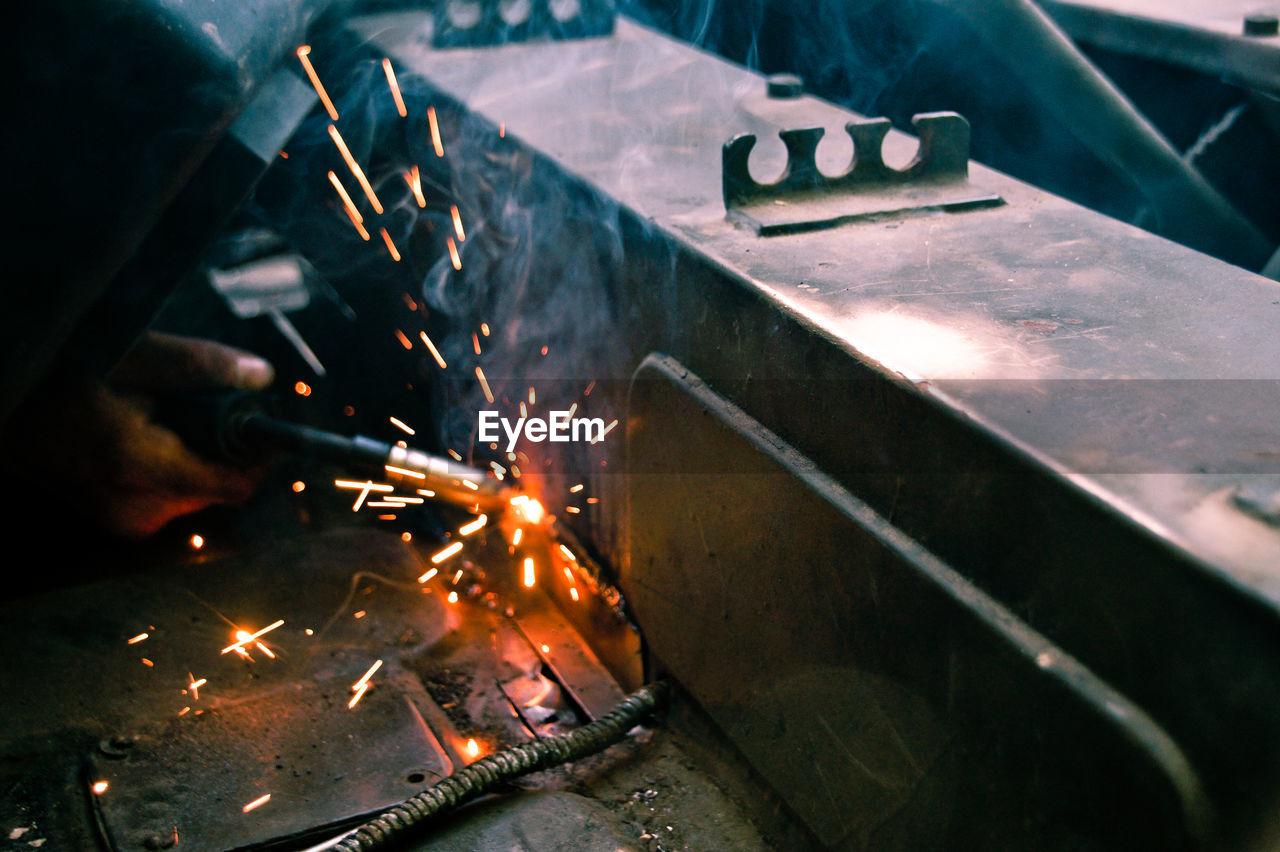 Close-Up Of Hand Welding Metal