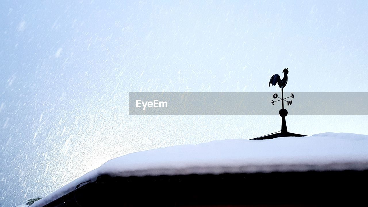 weather vane, weather, direction, snow, guidance, day, no people, roof, winter, nature, cold temperature, outdoors, silhouette, sky, bird, navigational compass, architecture, animal themes
