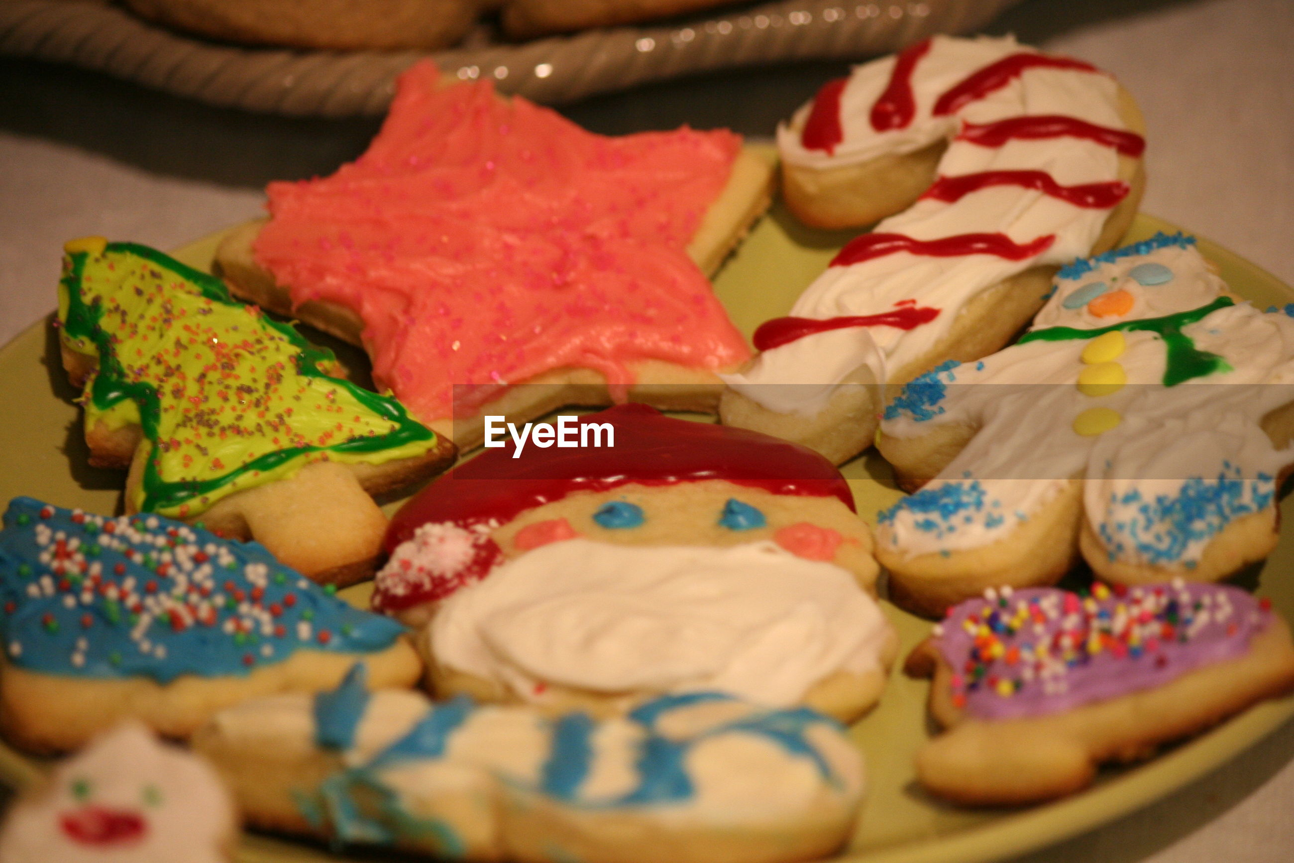 Close-up of colorful cookies served in plate on table
