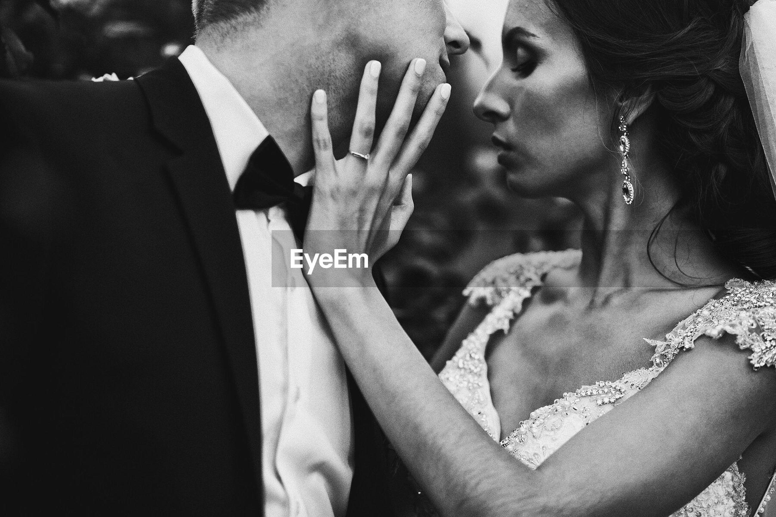 Cropped image of wedding couple