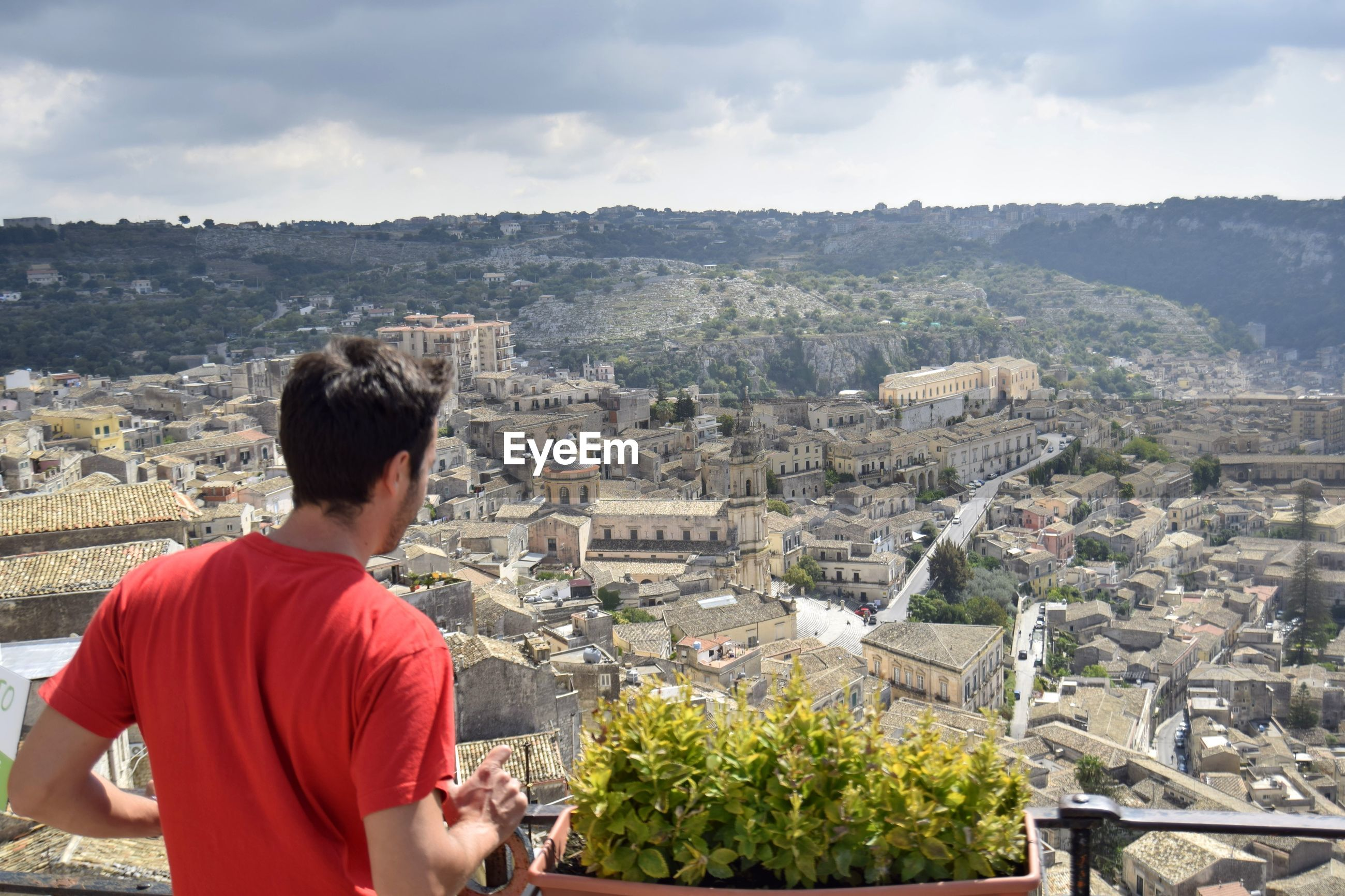 Man looking at cityscape