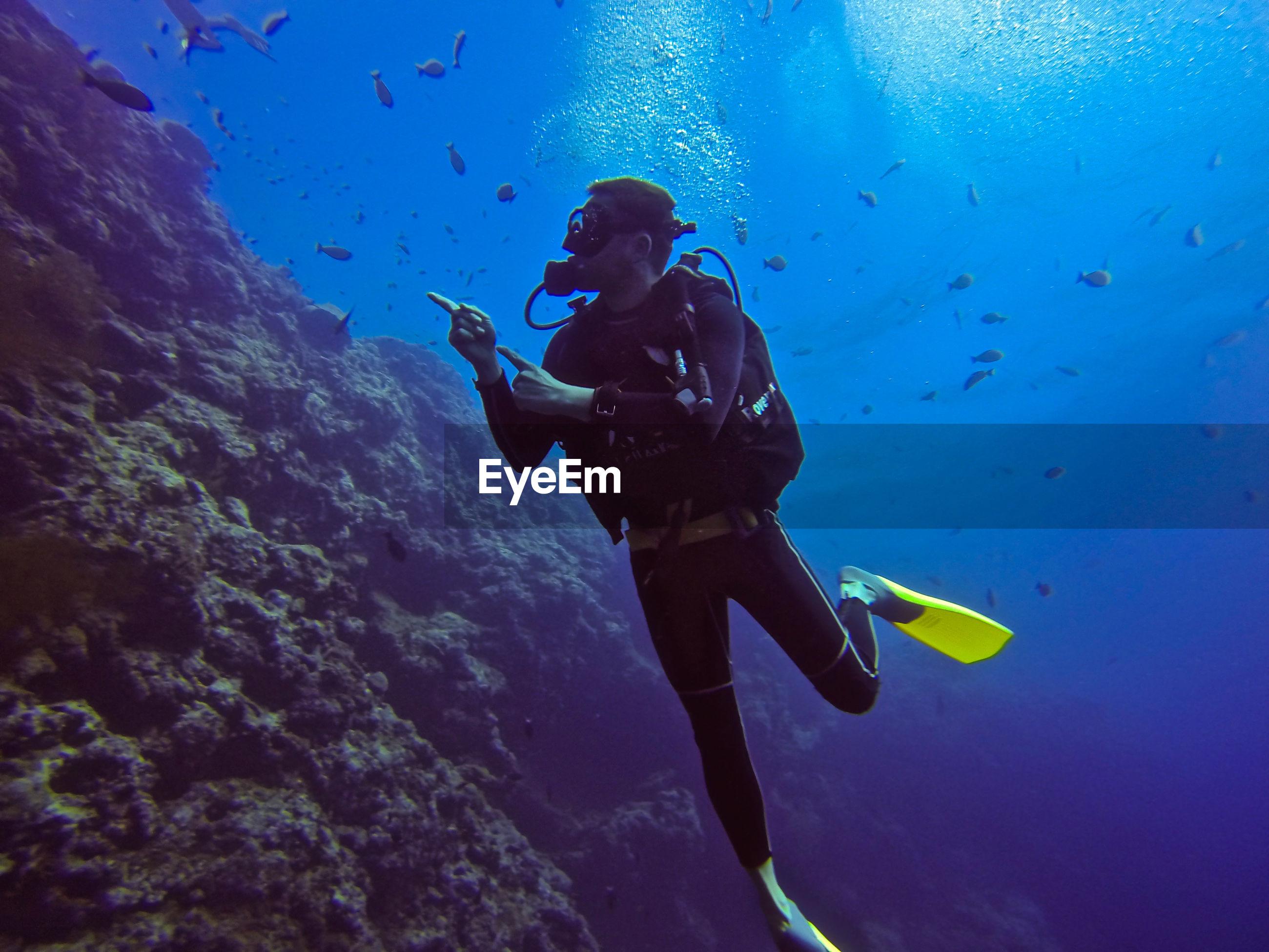 Full length of man scuba diving in sea