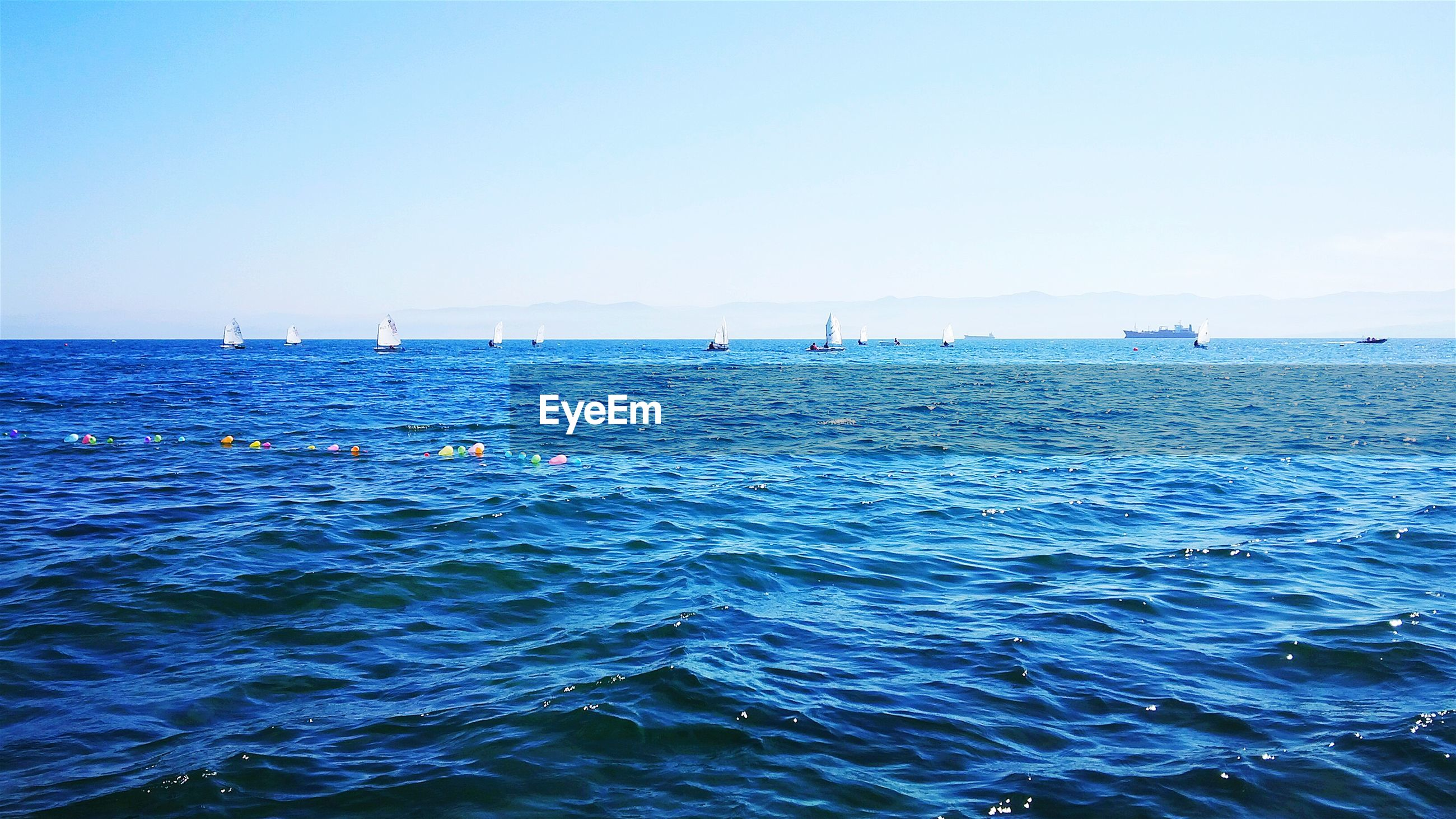 water, sea, blue, clear sky, waterfront, horizon over water, copy space, nautical vessel, rippled, tranquil scene, transportation, tranquility, scenics, beauty in nature, nature, mode of transport, boat, idyllic, seascape, day