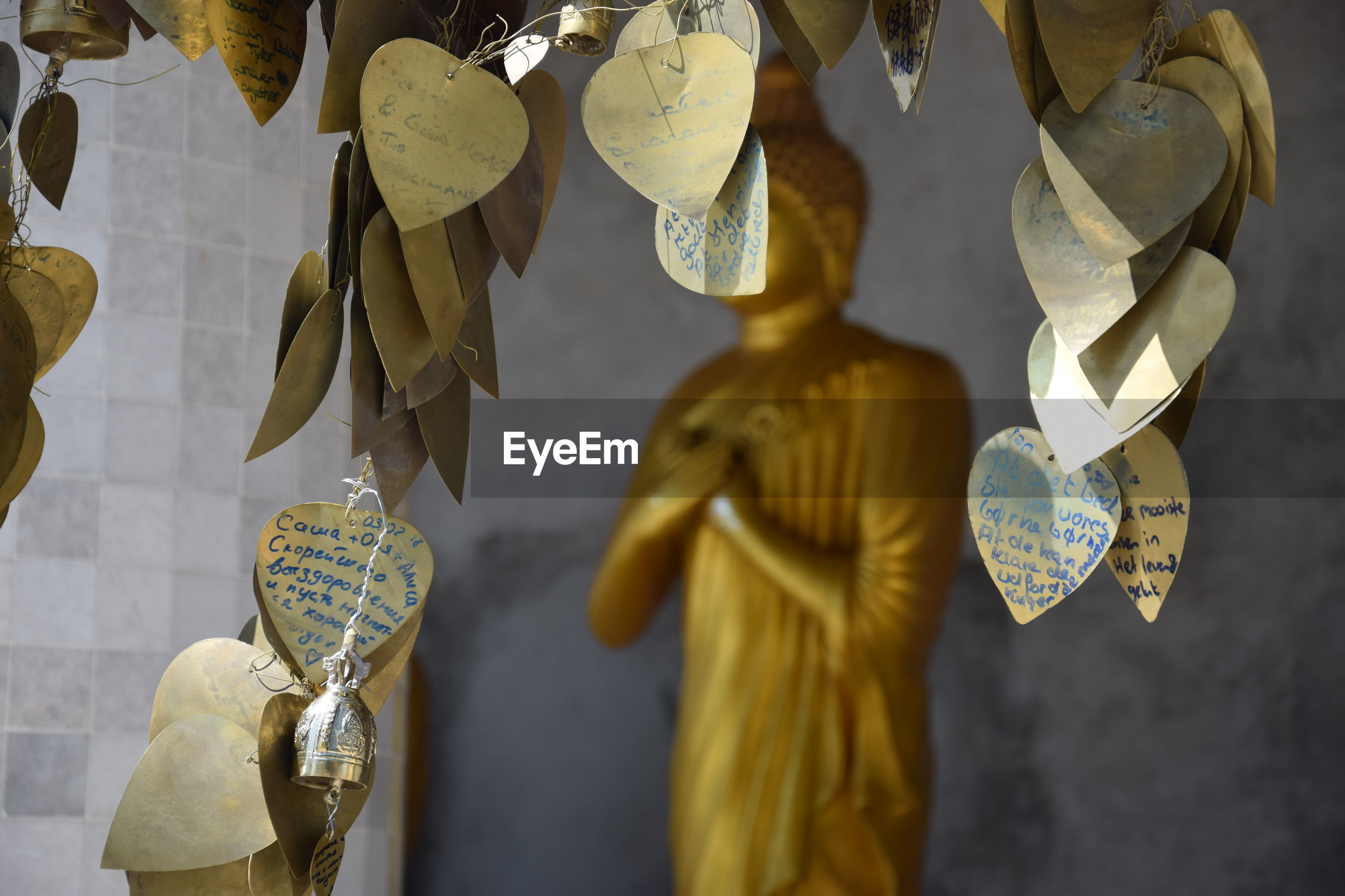 Heart shape cards hanging by statue