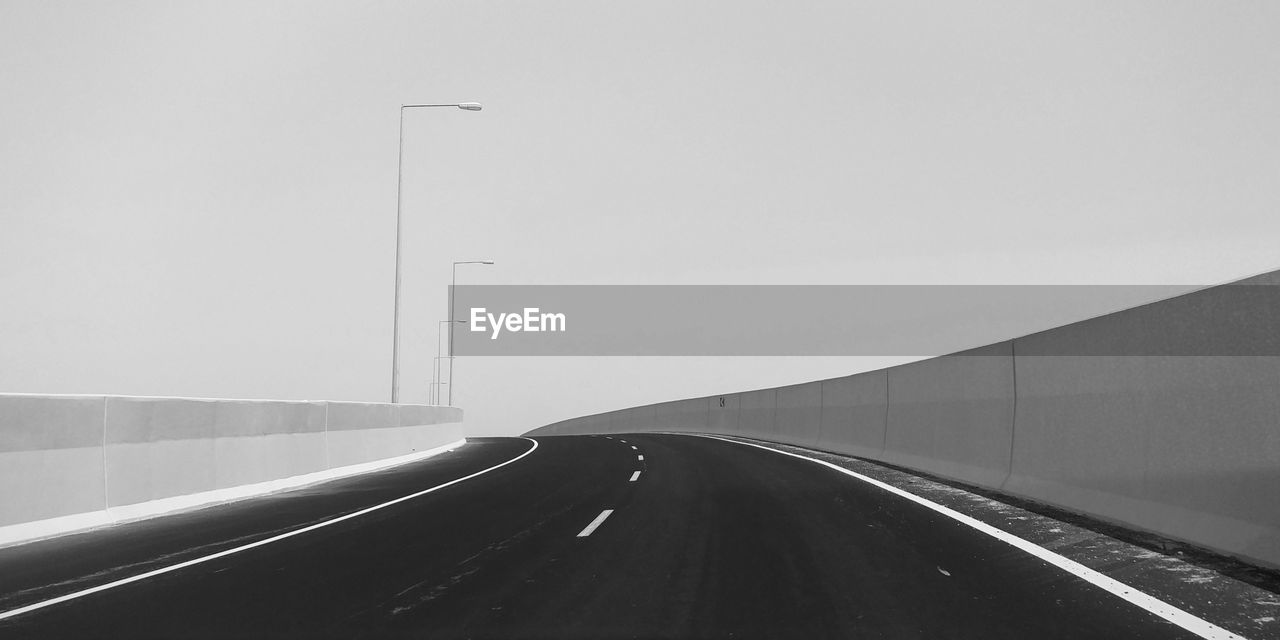 Empty Highway Against Clear Sky