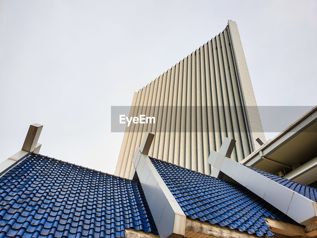 architecture, building exterior, built structure, low angle view, sky, building, clear sky, no people, pattern, roof, day, nature, modern, city, tall - high, office building exterior, outdoors, skyscraper, roof tile, house