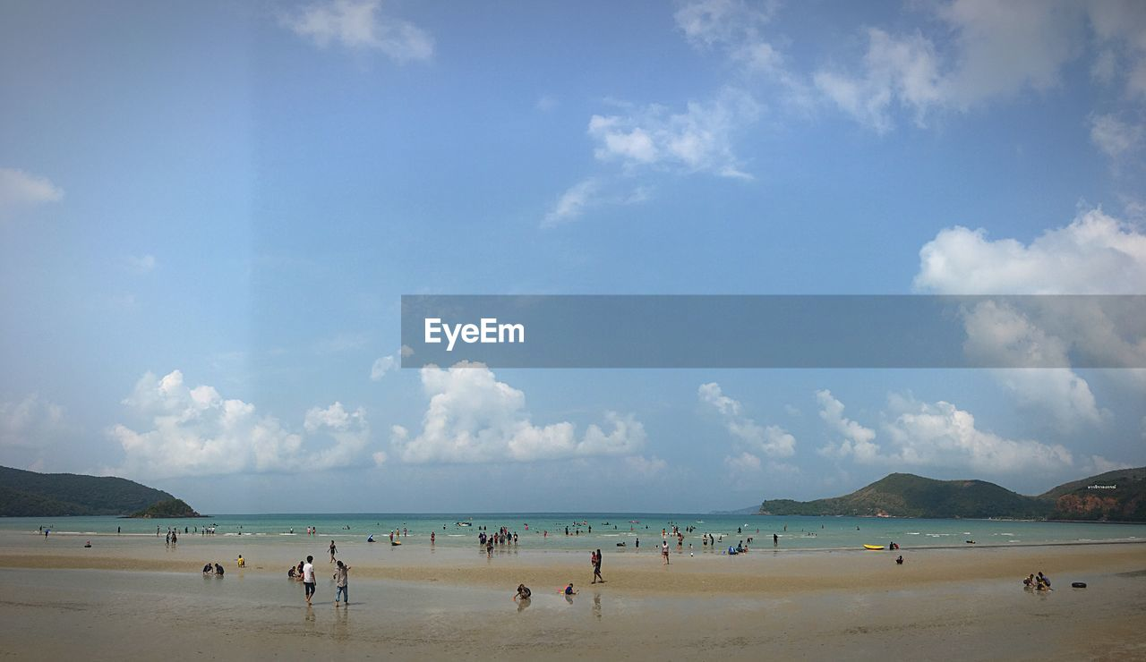 sky, sea, water, beach, land, cloud - sky, large group of people, day, group of people, beauty in nature, nature, holiday, real people, scenics - nature, vacations, trip, horizon over water, crowd, sand, outdoors