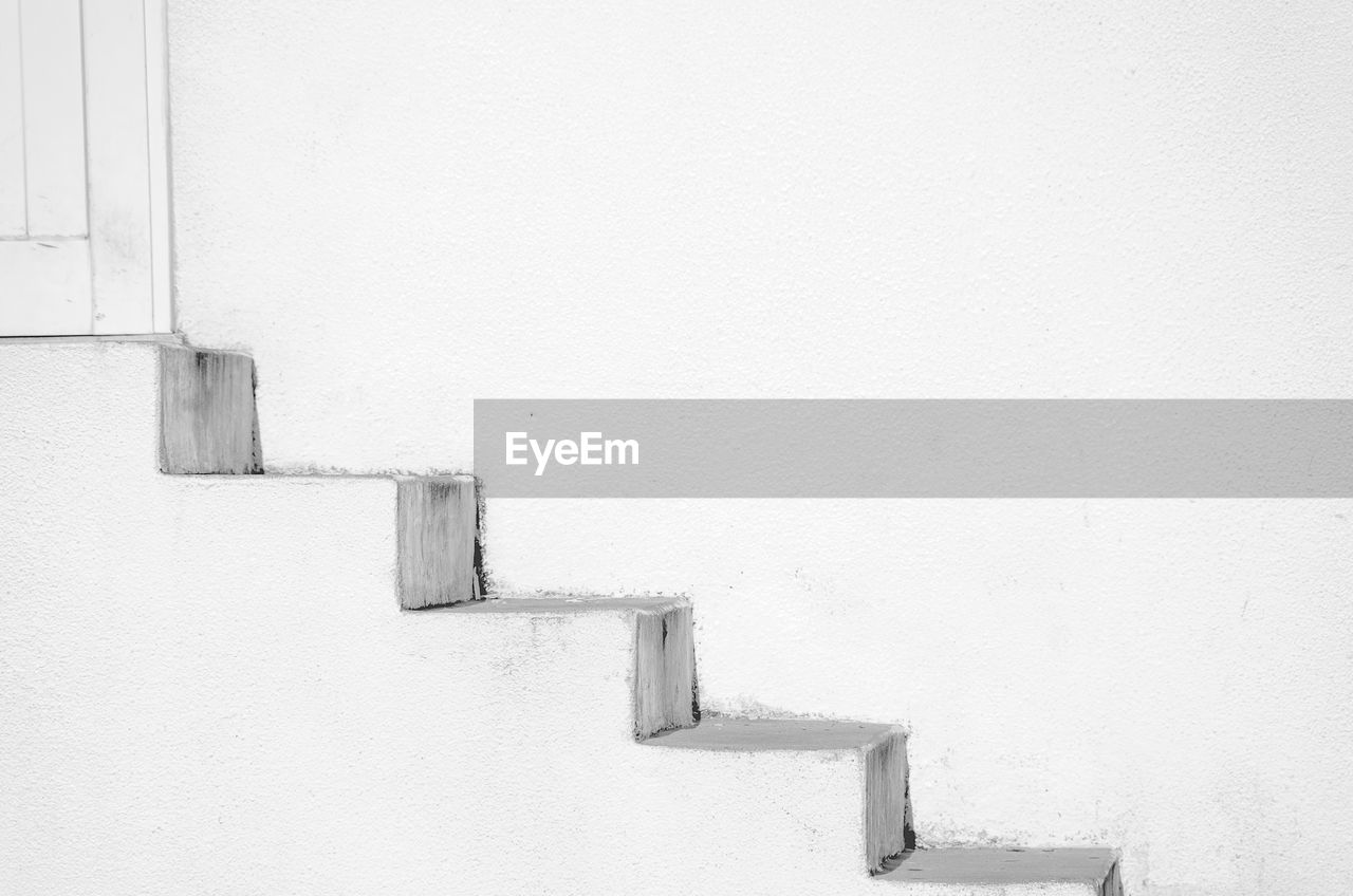 architecture, built structure, copy space, staircase, wall - building feature, white color, no people, day, steps and staircases, wall, building exterior, outdoors, white, building, railing, whitewashed, winter, pattern, cold temperature, nature, snowing