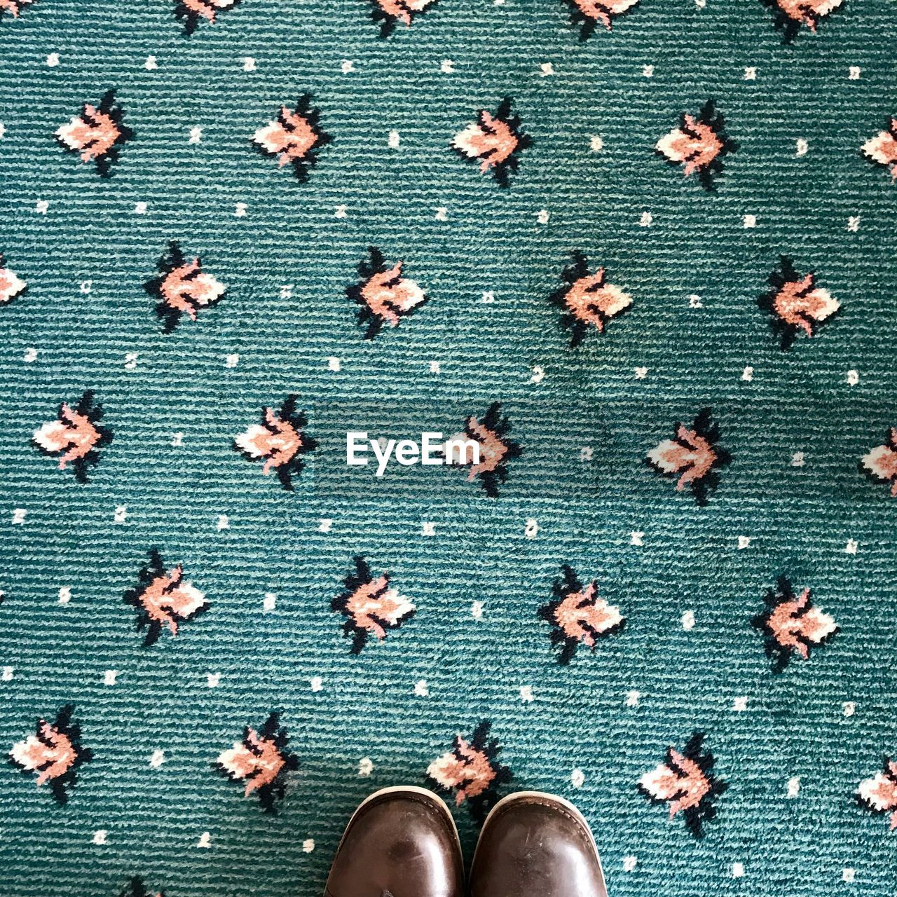 Directly above shot of shoes on carpet