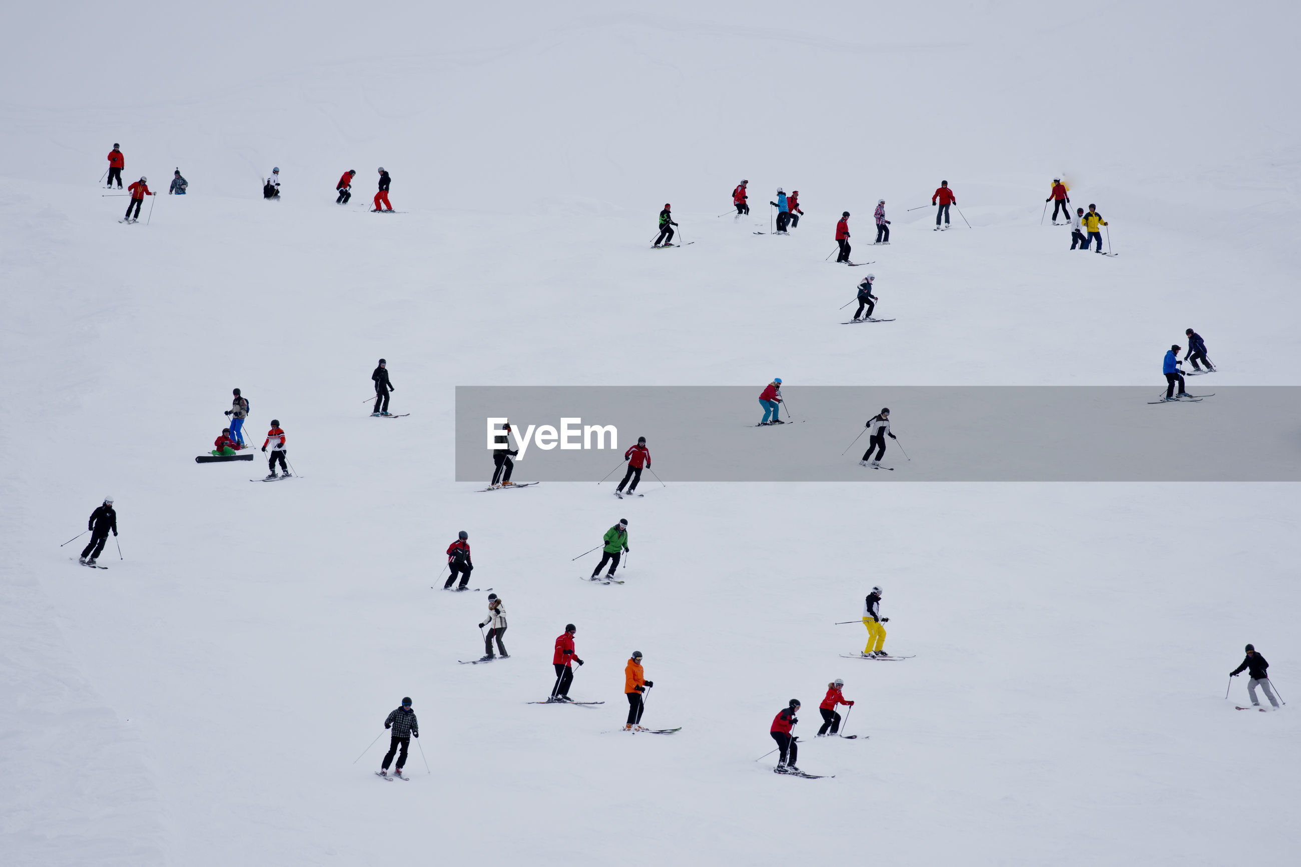 High angle view of people skiing on snow during winter