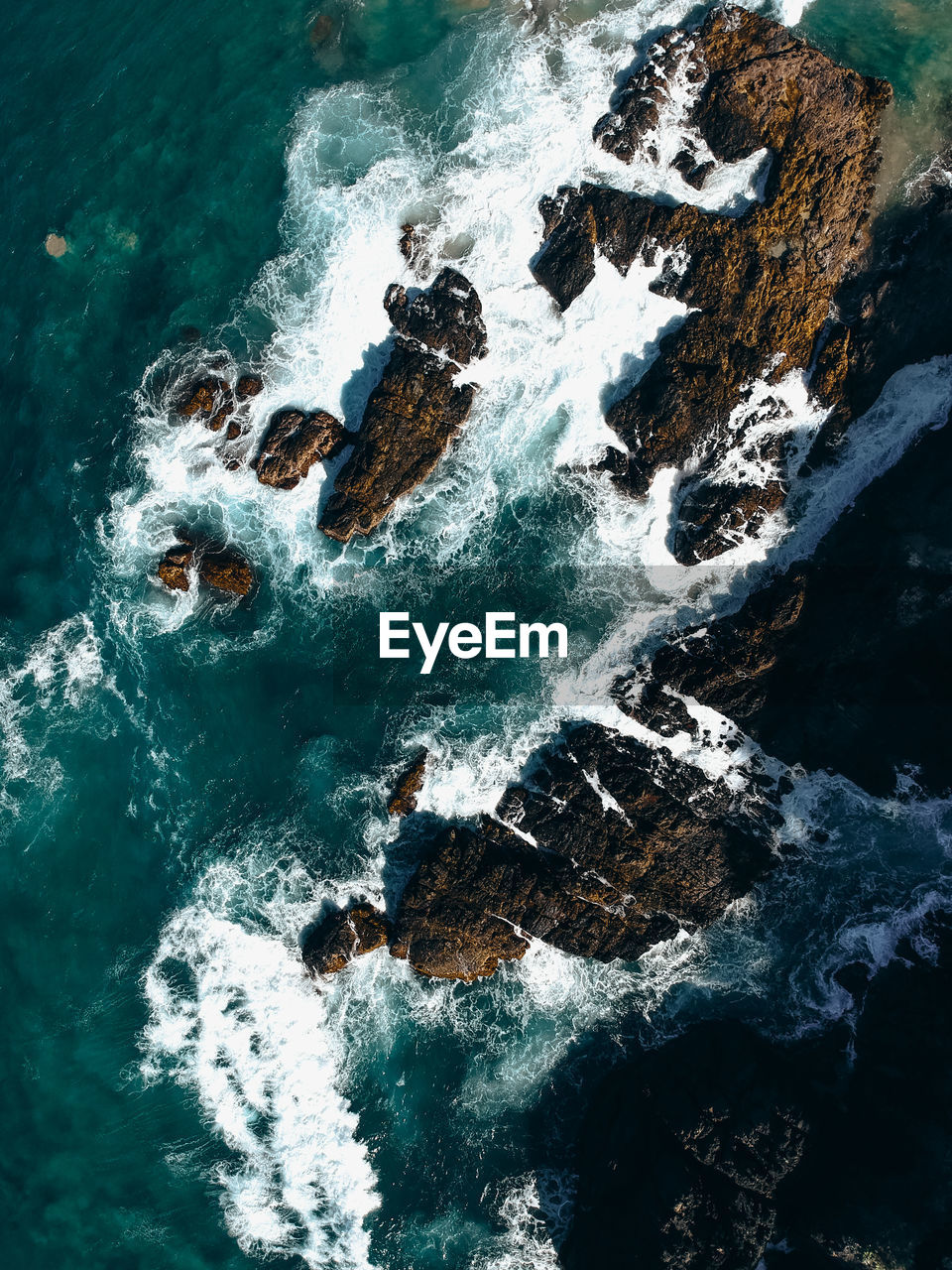 Aerial View Of Rocks In Sea